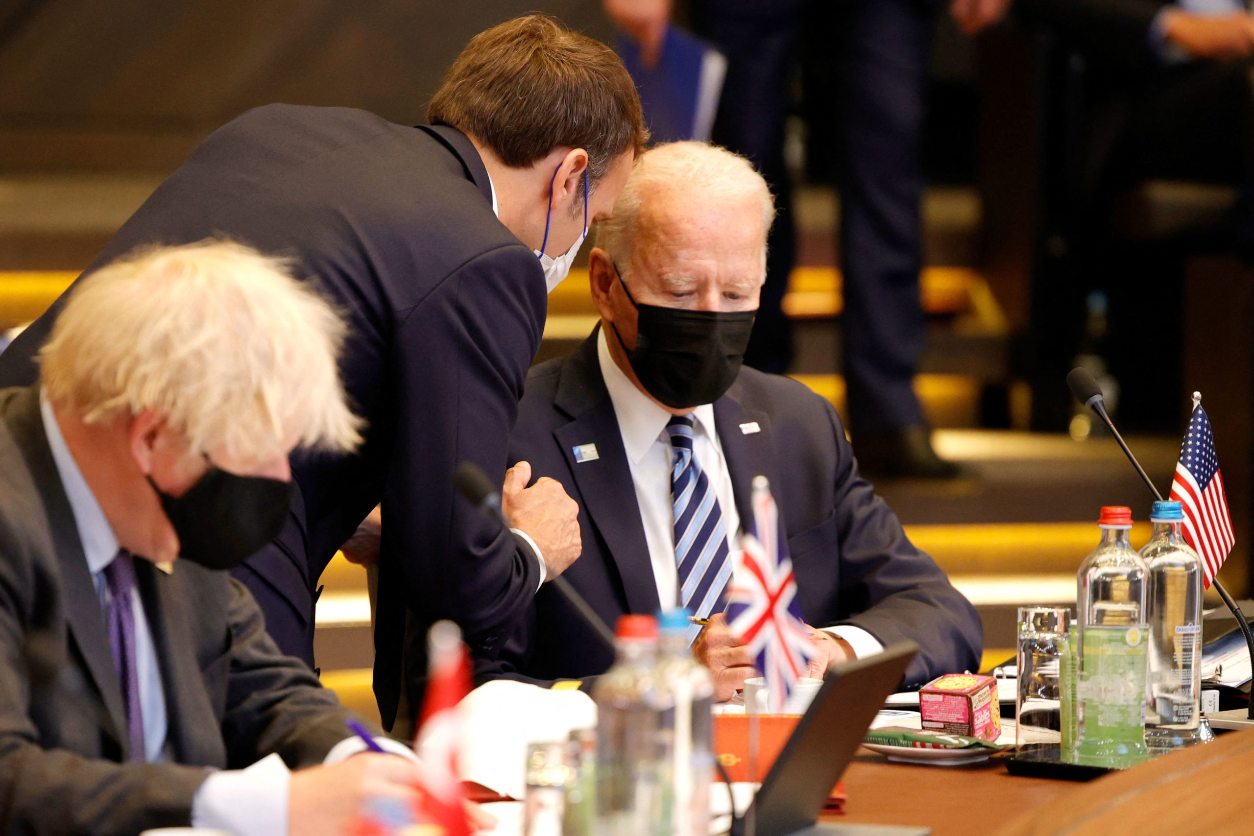 French President Emmanuel Macron (L) speaks with US President Joe Biden (R) during a plenary session of a NATO summit at the North Atlantic Treaty Organization (NATO) headquarters in Brussels, on June 14, 2021.