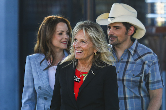 US first lady Jill Biden (C), accompanied by country singer Brad Paisley (R) and his wife actress Kimberly Williams Paisley, tours a Covid-19 vaccination site at Ole Smoky Distillery in Nashville, Tennessee, June 22, 2021. (Photo by TOM BRENNER/POOL/AFP via Getty Images)