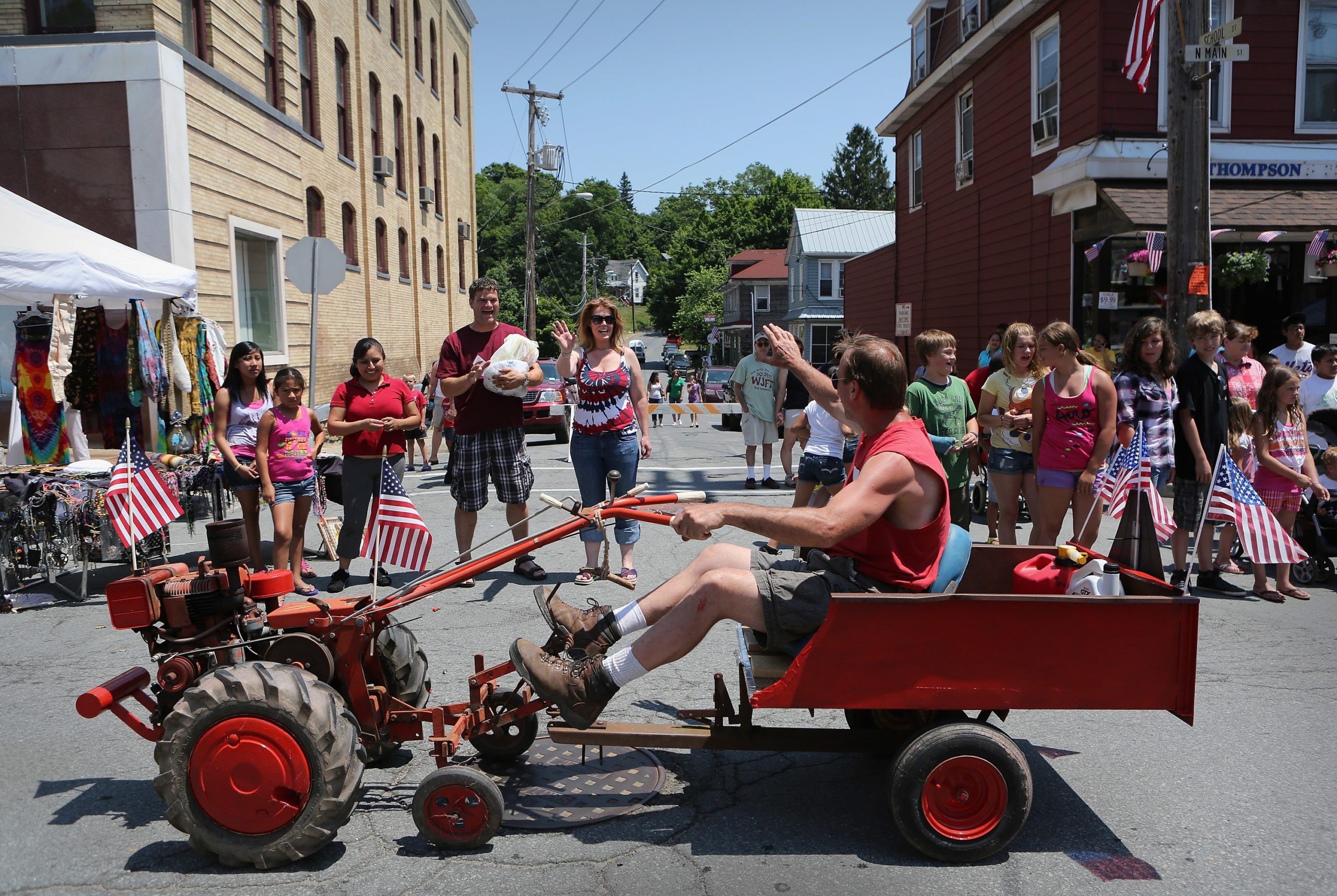 Residents watch a 4th of July parade during the Liberty Festival on July 4, 2012 in Liberty, New York. Communities around the country celebrated Independence Day with parades and shows of patriotism. (Photo by John Moore/Getty Images)