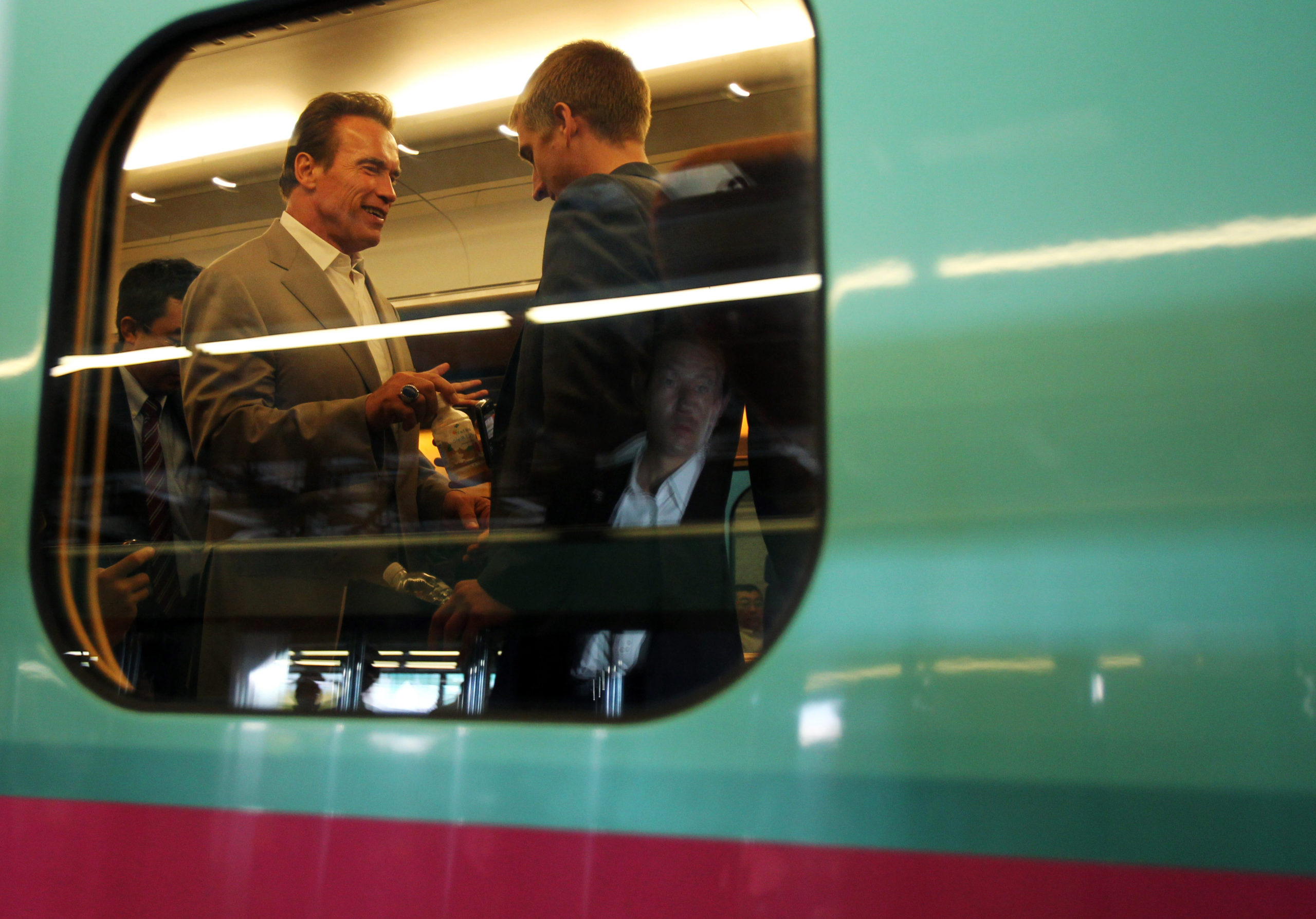 Former California Gov. Arnold Schwarzenegger chats during an inspection of a high-speed train on Sept. 14, 2010. (Shuji Kajiyama/AFP via Getty Images)