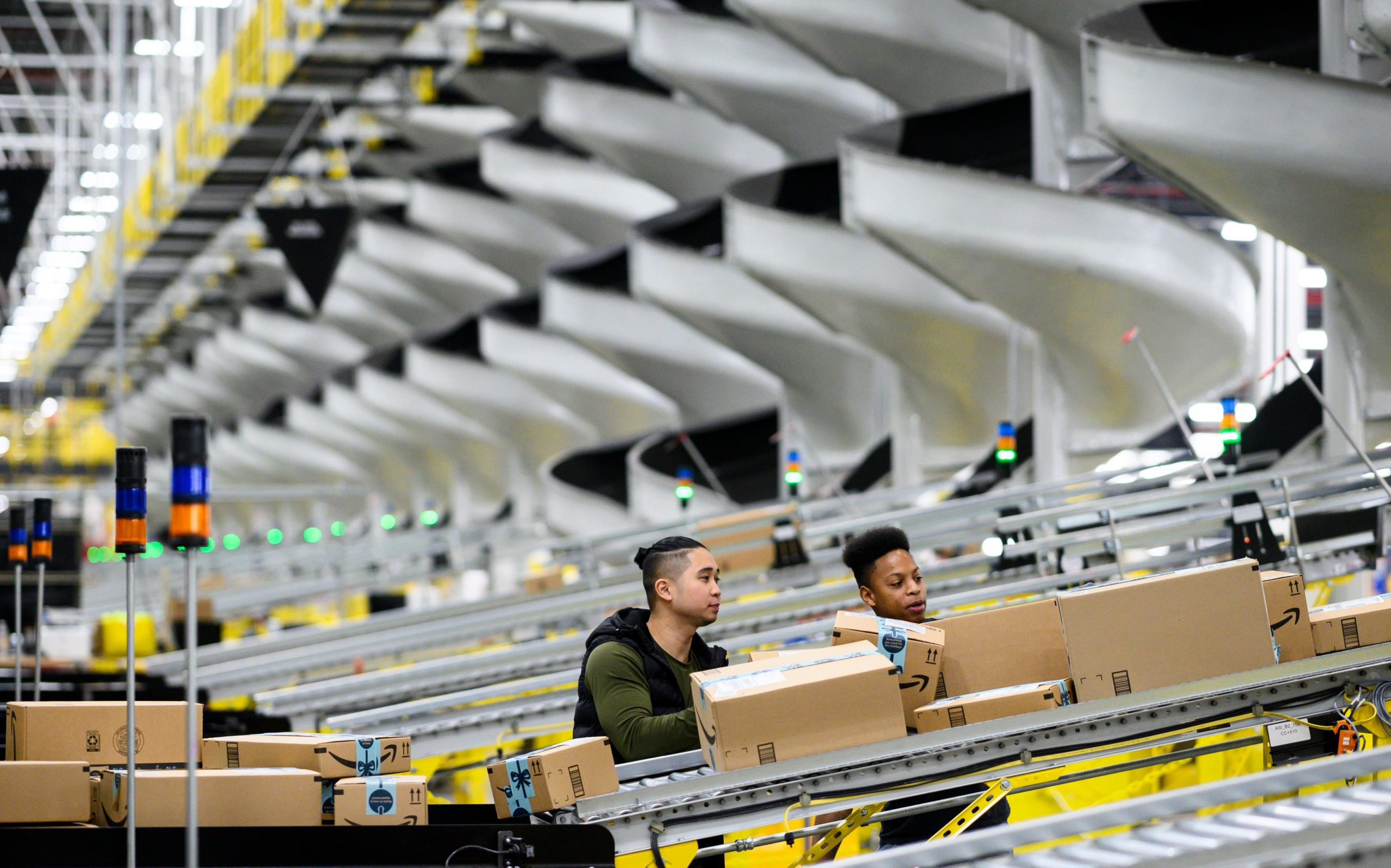 Amazon employees work on Feb. 5, 2019 at a New York City warehouse. (Johannes Eisele/AFP via Getty Images)