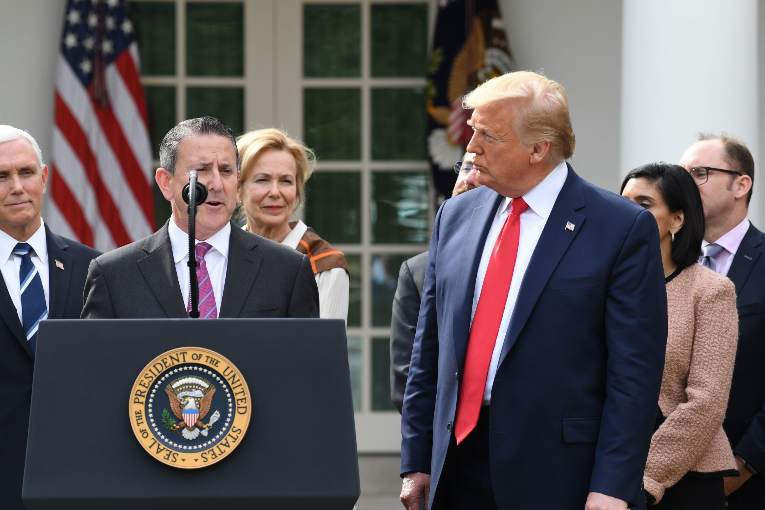 Brian Cornell, Chairman and CEO of Target, speaks as former President Donald Trump listens on March 13, 2020. (Saul Loeb/AFP via Getty Images)