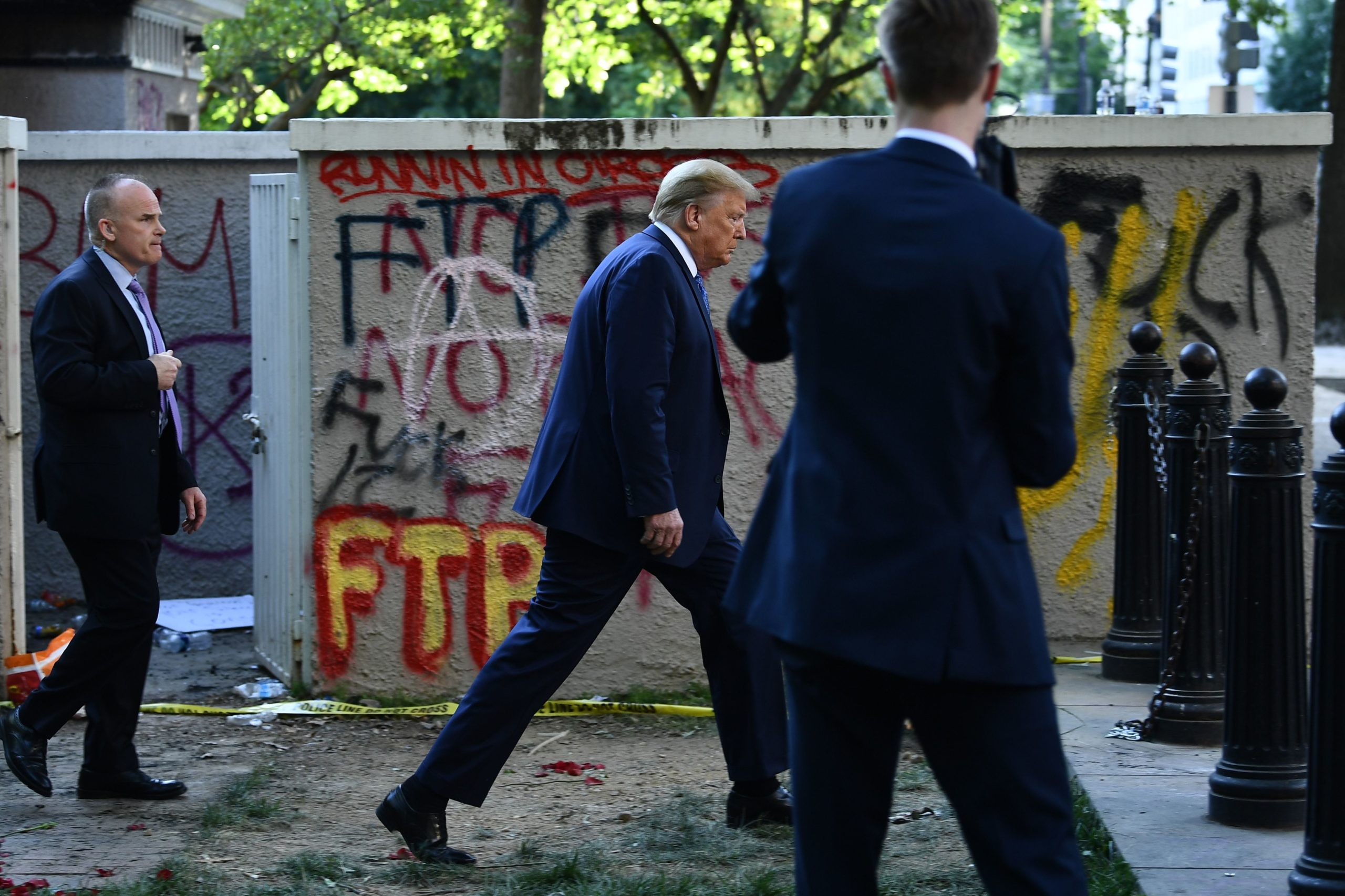 US President Donald Trump walks back to the White House escorted by the Secret Service after appearing outside of St John's Episcopal church across Lafayette Park in Washington, DC on June 1, 2020. (BRENDAN SMIALOWSKI/AFP via Getty Images)