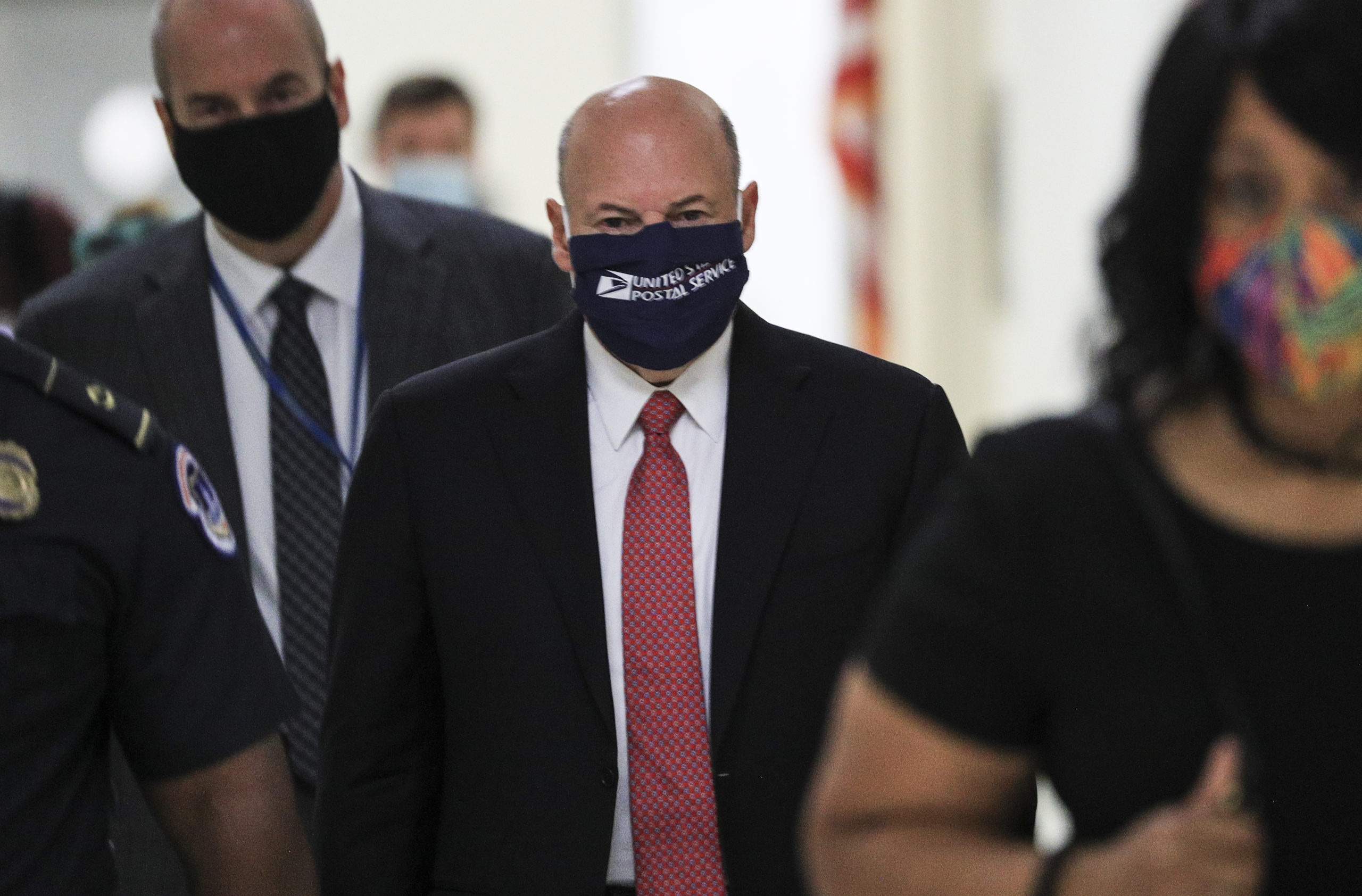 Postmaster General Louis DeJoy arrives for a House Oversight and Reform Committee hearing on Aug. 24. (Tom Brenner/Pool/Getty Images)