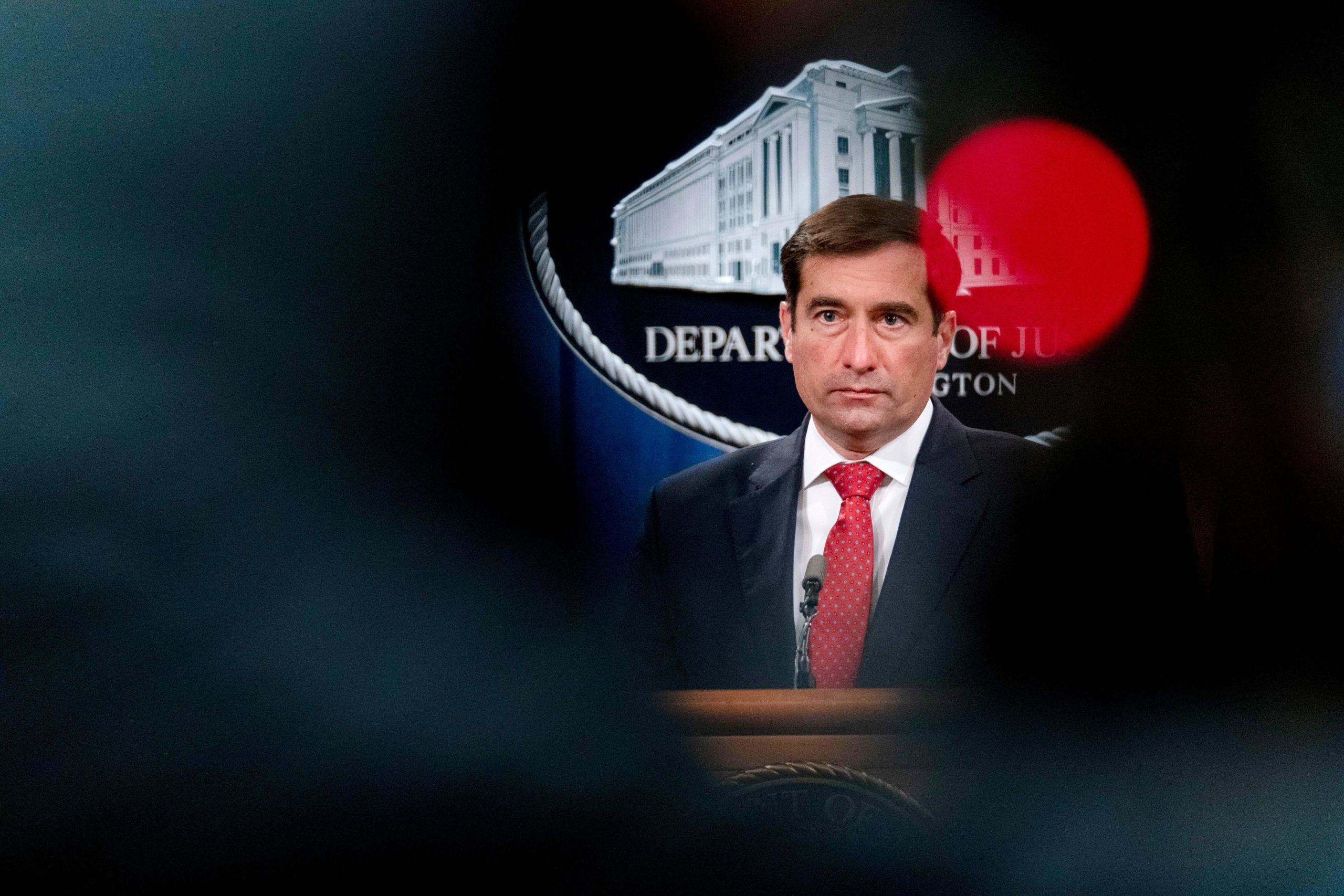 Assistant Attorney General for the National Security Division John Demers speaks at a news conference at the Department of Justice, October 19, 2020, in Washington, DC. (ANDREW HARNIK/POOL/AFP via Getty Images)
