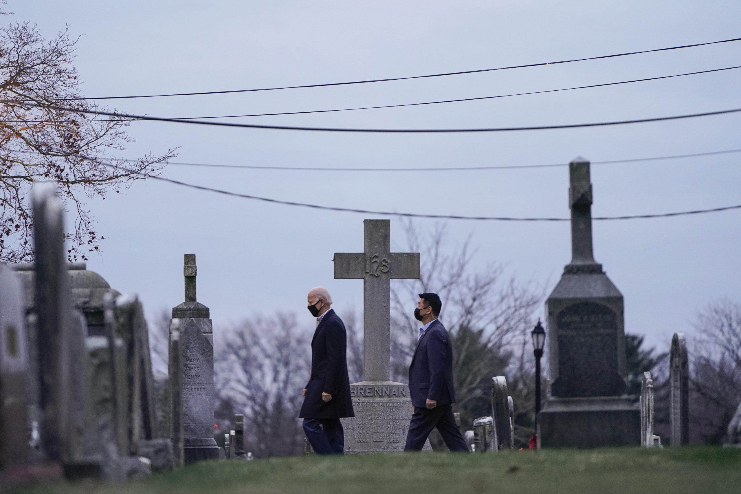 President Joe Biden is followed by Secret Service agents as he departs after Mass in Wilmington, Delaware in December. (Joshua Roberts/Getty Images)