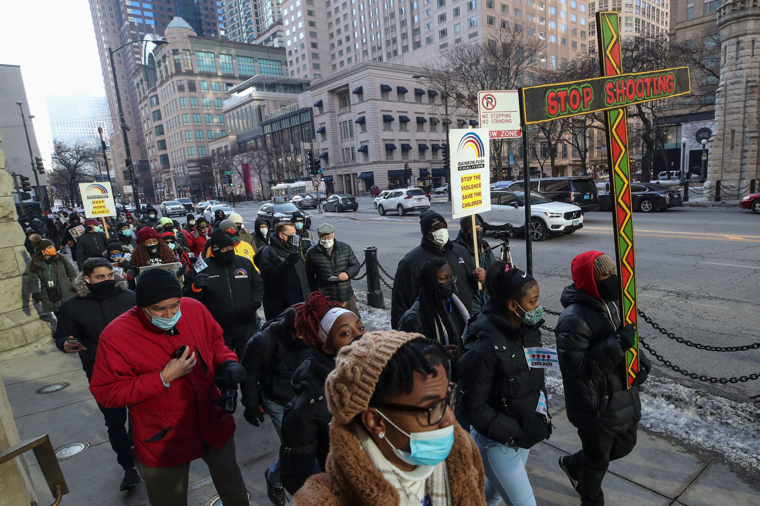 People walk during an anti-gun violence march on in Chicago, Illinois, on Dec. 31, 2020. (Kamil Krzaczynski/AFP via Getty Images)