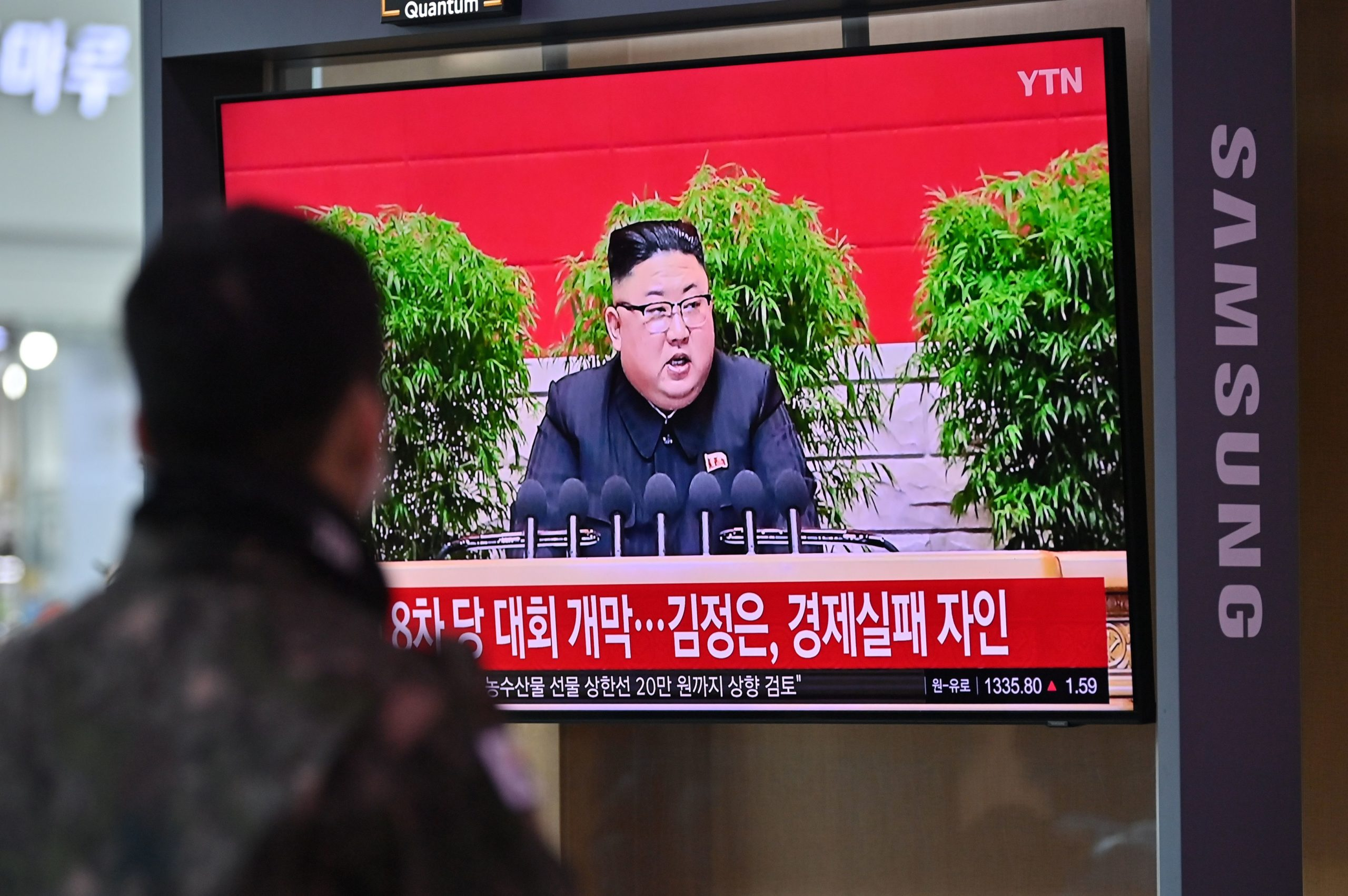 A man watches a television screen showing news footage of North Korean leader Kim Jong Un in Seoul on Jan. 6. (Jung Yeon-je/AFP via Getty Images)