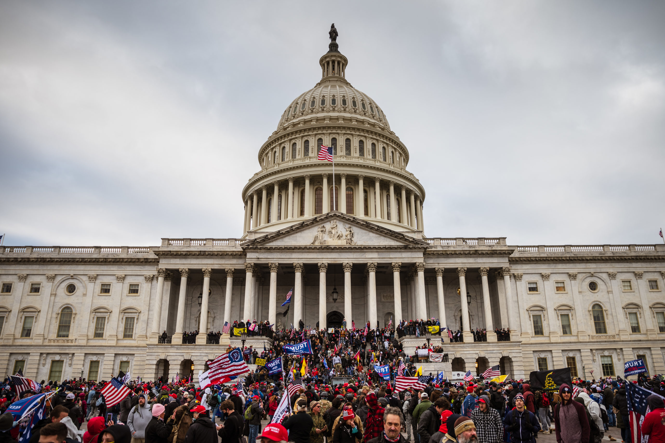 A large group of pro-Trump protesters stand on the East steps of the Capitol Building after storming its grounds on January 6, 2021 in Washington, DC. (Jon Cherry/Getty Images)