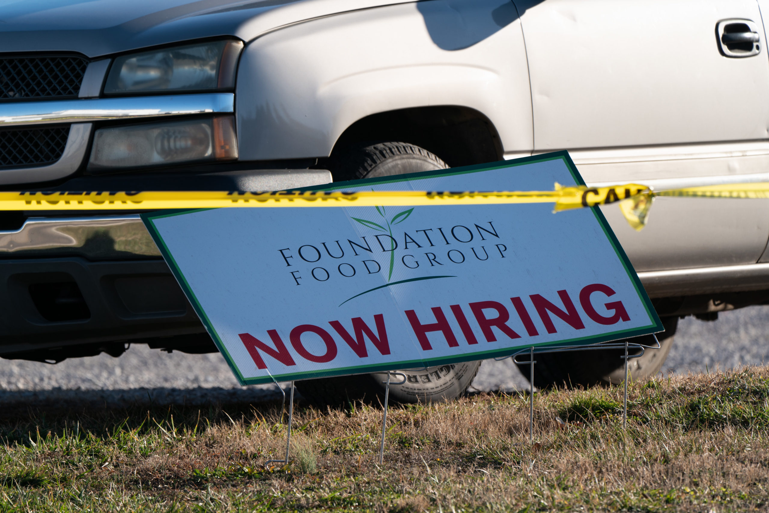 """A """"Now Hiring"""" sign is seen outside a Prime Pak Foods poultry processing plant in Gainesville, Georgia. (Elijah Nouvelage/AFP via Getty Images)"""