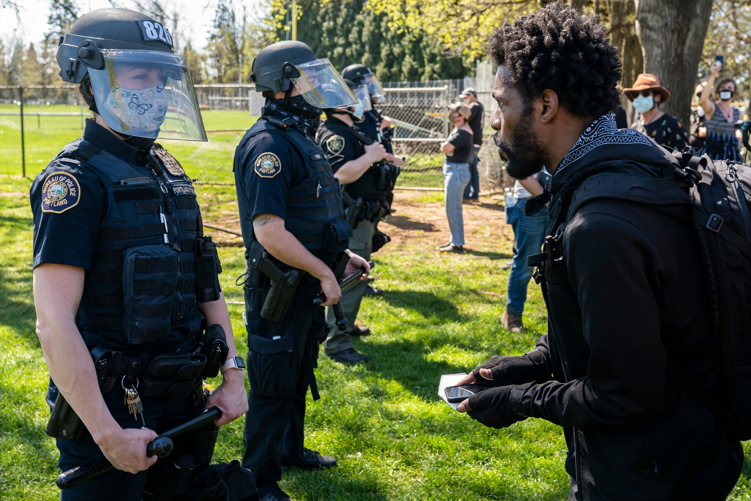 A protester argues with a Portland riot officer following the police shooting of a homeless man in Lents Park on April 16, 2021 in Portland, Oregon. (Photo by Nathan Howard/Getty Images)