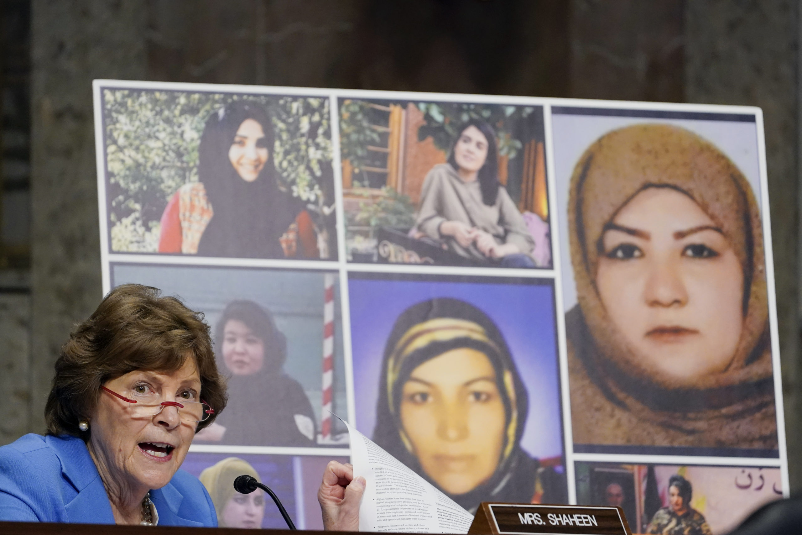 U.S. Sen. Jeanne Shaheen (D-NH) talks about women in Afghanistan, including the seven pictured women who were killed in Afghanistan, as she questions Zalmay Khalilzad, special envoy for Afghanistan Reconciliation, while he testifies before the Senate Foreign Relations Committee on April 27, 2021 in Washington, DC. (Photo by Susan Walsh-Pool/Getty Images)