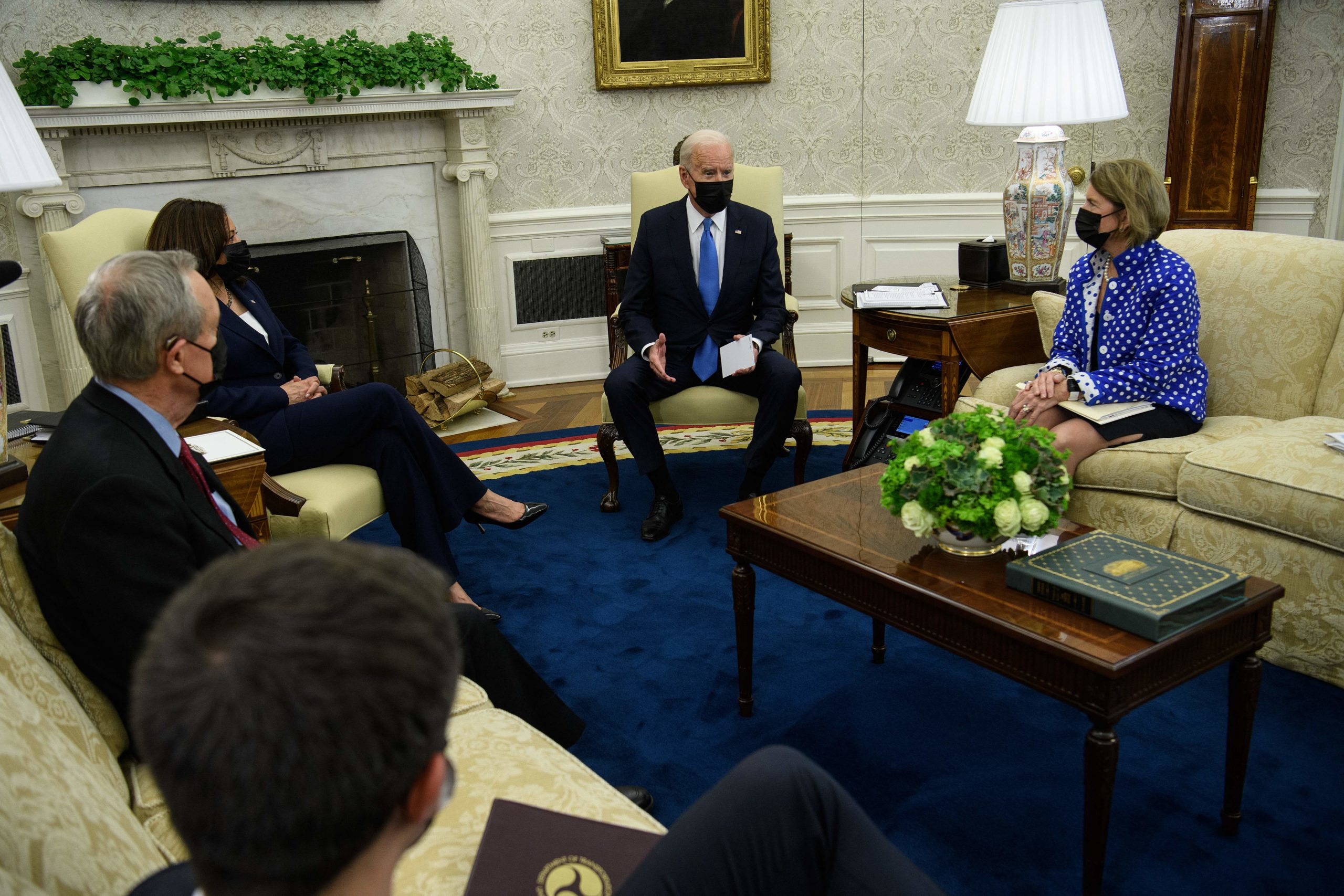 US President Joe Biden(C) and Vice President Kamala Harris(L) meet with Republican Senator from West Virginia Shelley Moore Capito (R) and Republican Senator Mike Crapo of Idaho (frontL) to discuss an infrastructure bill in the Oval Office at the White House in Washington, DC, on May 13, 2021. (NICHOLAS KAMM/AFP via Getty Images)