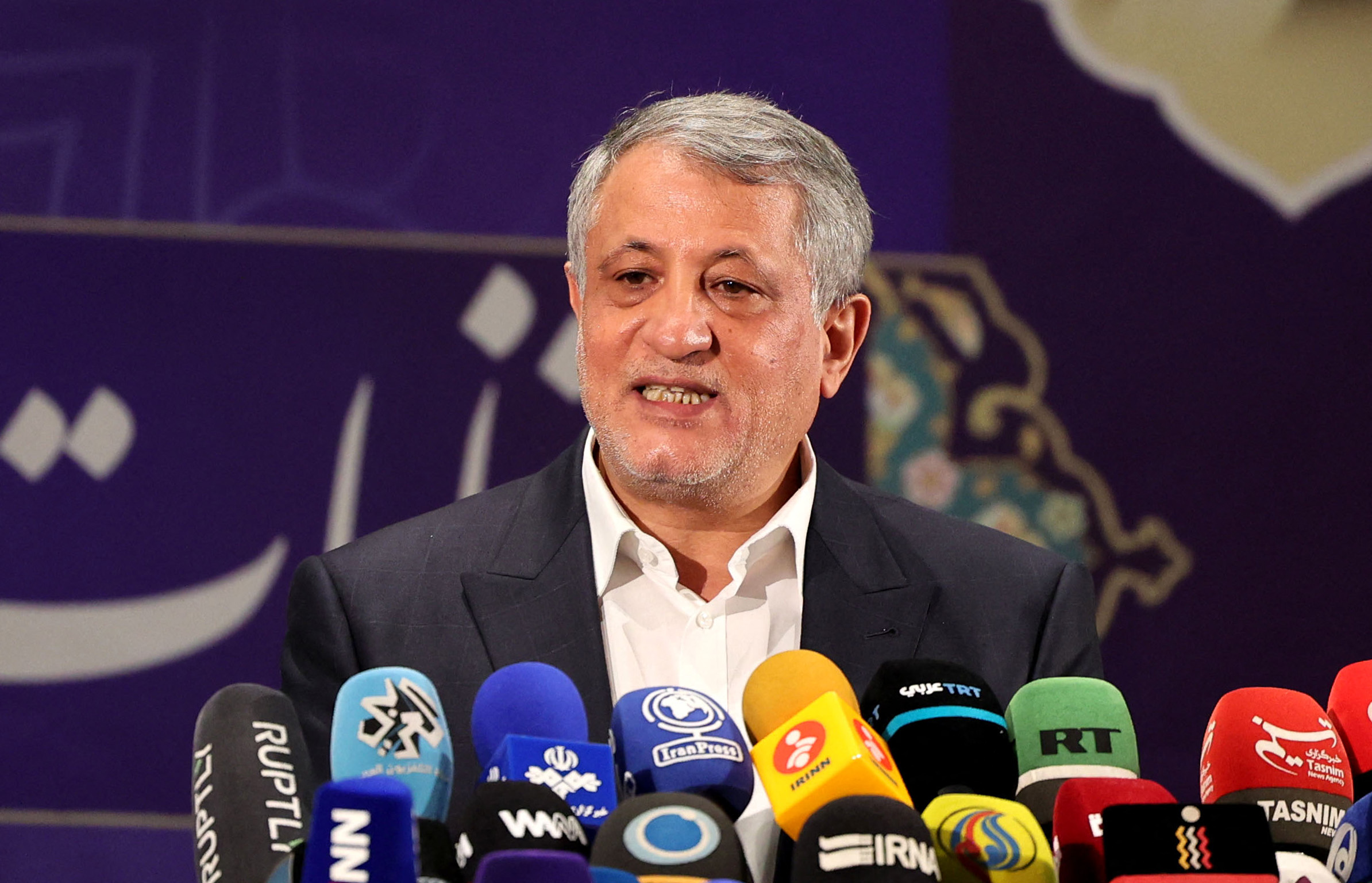 Mohsen Hashemi Rafsanjani, son of late former Iranian president Akbar Hashemi Rafsanjani, delivers a speech after registering his candidacy for Iran's presidential elections, at the Interior Ministry in capital Tehran, on May 15, 2021, ahead of the presidential elections scheduled for June. (Photo by ATTA KENARE / AFP) (Photo by ATTA KENARE/AFP via Getty Images)