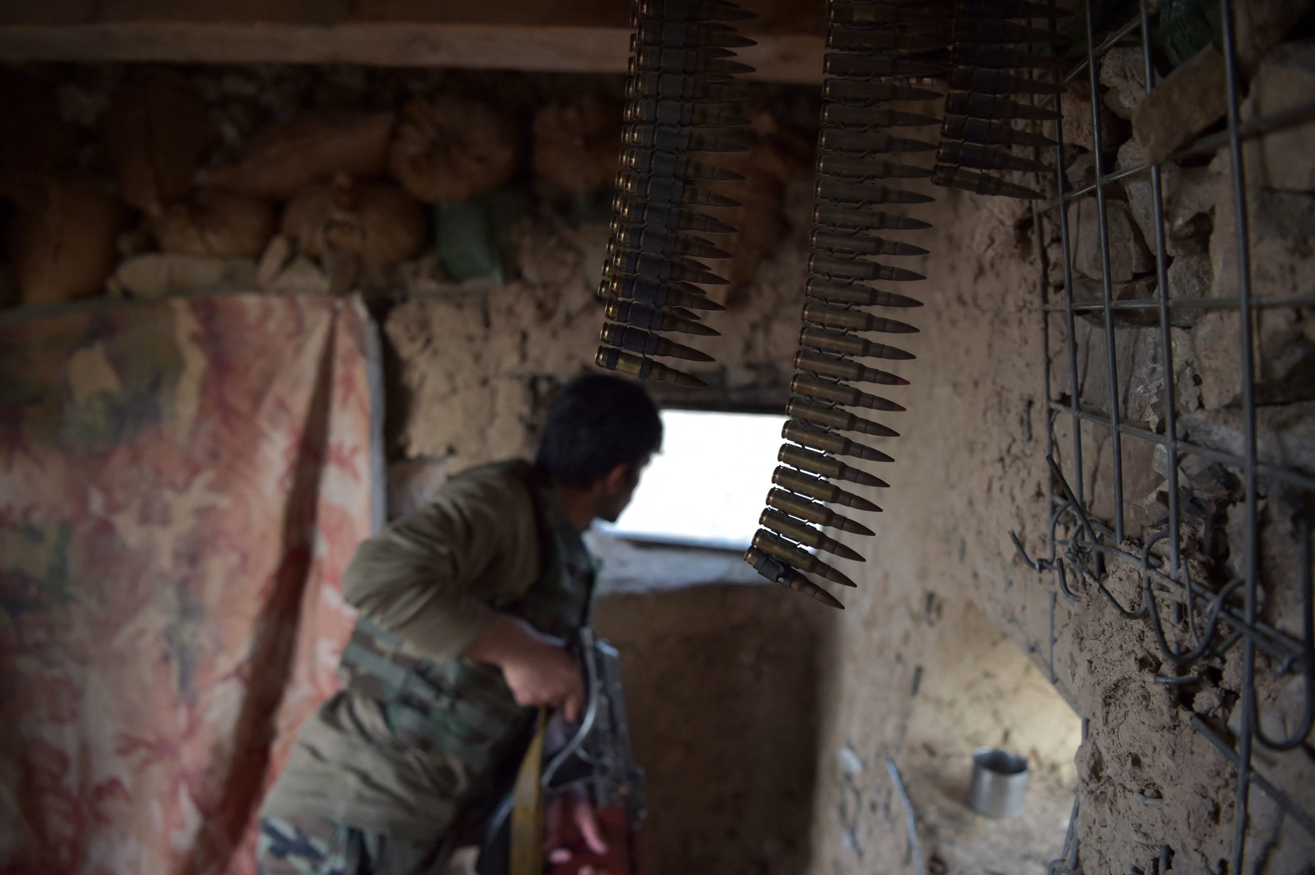 In this photograph taken on March 23, 2021, an Afghan National Army (ANA) soldier keeps watch at an outpost set up against Taliban fighters in Kajaki, northeast of Helmand Province.(Photo by WAKIL KOHSAR/AFP via Getty Images)