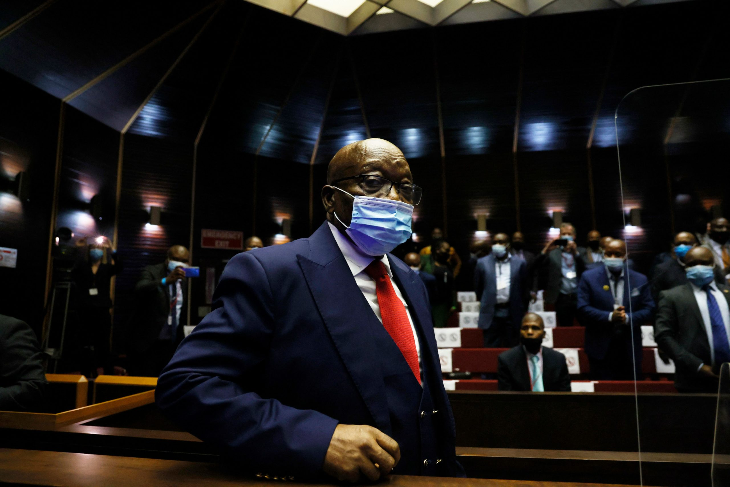 Former South African President Jacob Zuma arrives ahead of his corruption trial at the Pietermaritzburg High Court in Pietermaritzburg, South Africa, on May 26, 2021. - Jacob Zuma faces 16 charges of fraud, graft and racketeering relating to a 1999 purchase of fighter jets, patrol boats and military gear from five European arms firms for 30 billion rand, then the equivalent of nearly $5 billion. He is accused of accepting bribes totalling four million rand from one of the firms, French defence giant Thales. (Photo by PHILL MAGAKOE / POOL / AFP) (Photo by PHILL MAGAKOE/POOL/AFP via Getty Images)