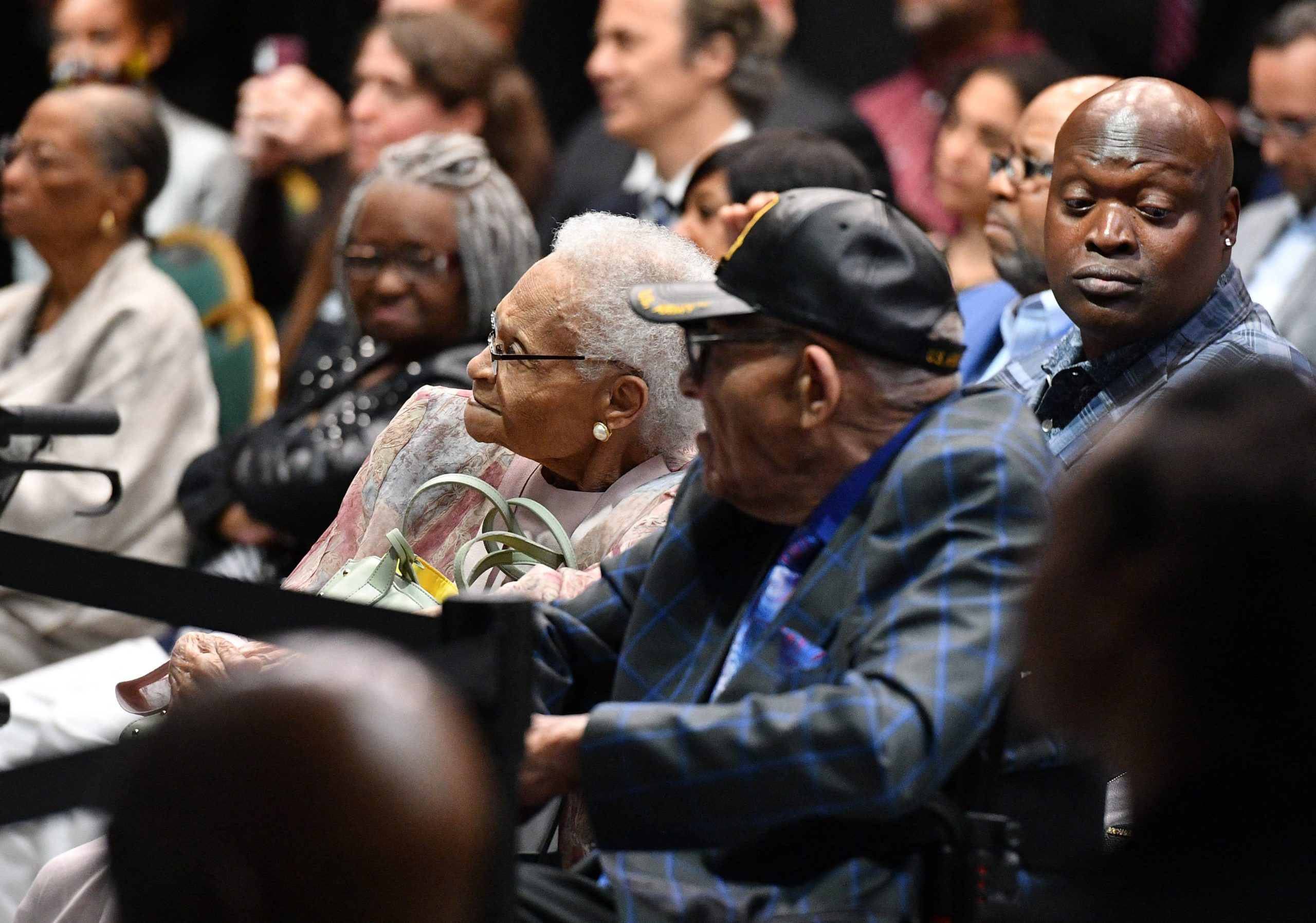 Tulsa race massacre Survivors Viola Fletcher (C) and Hughes Van Ellis (C R) listen to US President Joe Biden as he speaks on the 100th anniversary of the Tulsa Race Massacre at the Greenwood Cultural Center in Tulsa, Oklahoma on June 1, 2021. - US President Joe Biden traveled Tuesday to Oklahoma to honor the victims of a 1921 racial massacre in the city of Tulsa, where African American residents are hoping he will hear their call for financial reparations 100 years on. (Photo by MANDEL NGAN / AFP) (Photo by MANDEL NGAN/AFP via Getty Images)