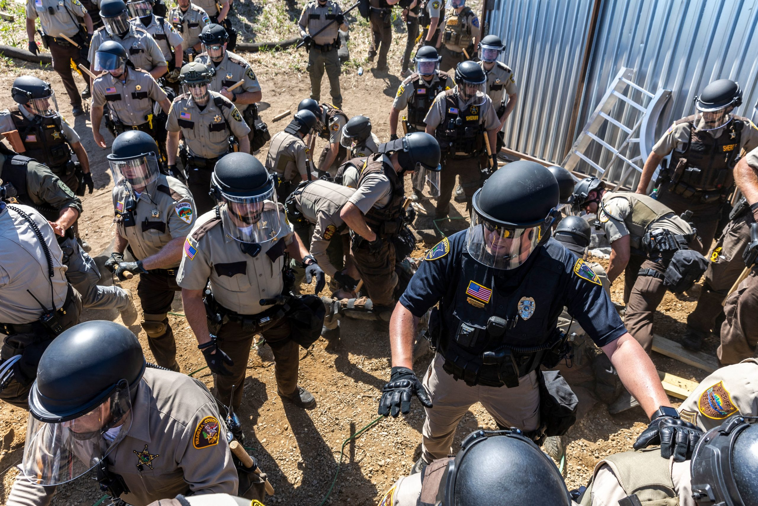 Police in riot gear arrest environmental activists at the Line 3 pipeline pumping station near Itasca State Park in Minnesota on Monday. (Kerem Yucel/AFP via Getty Images)