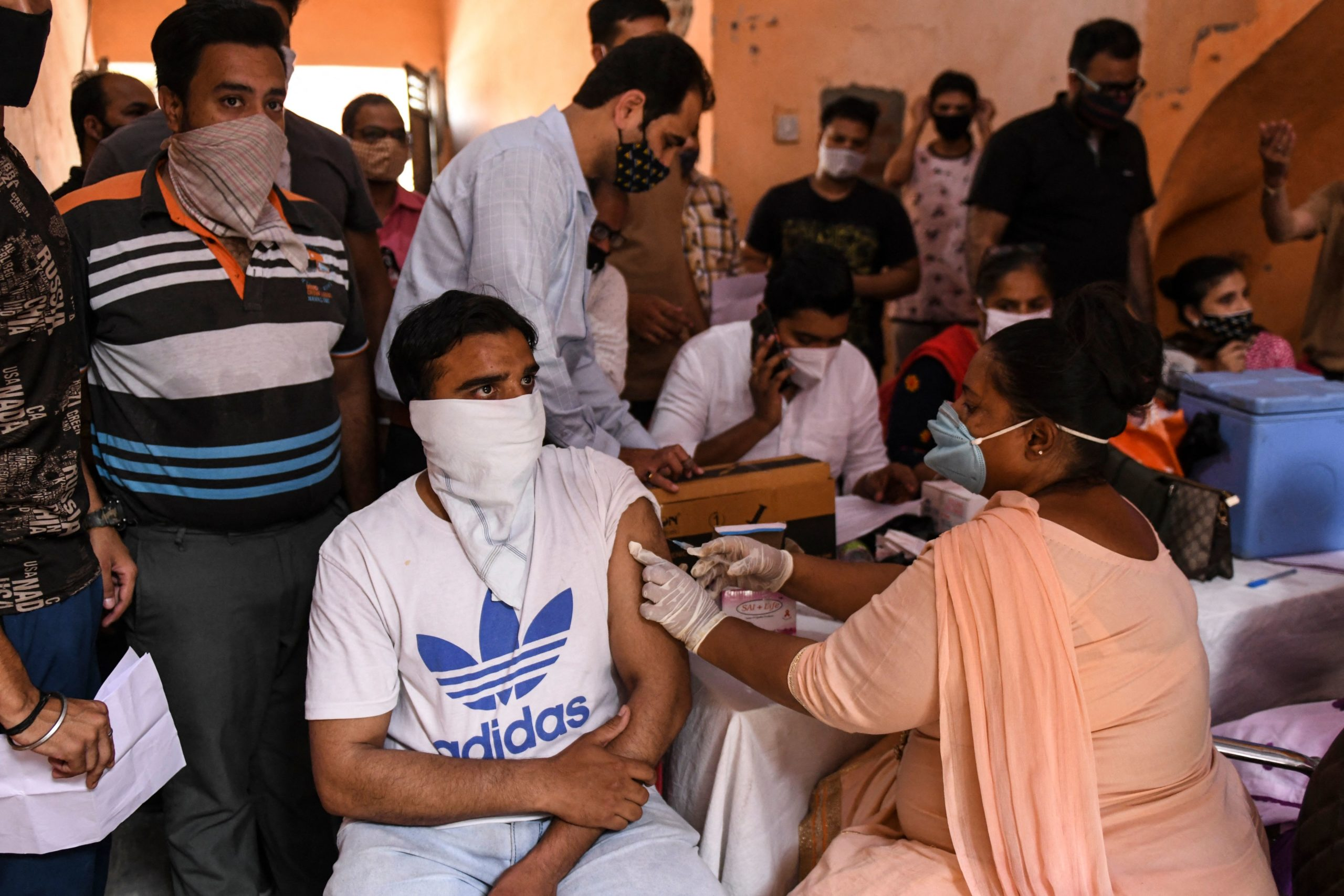 A health worker inoculates a student with a dose of the Covishield vaccine against the Covid-19 coronavirus during a vaccination camp in Amritsar on June 8, 2021. (NARINDER NANU/AFP via Getty Images)