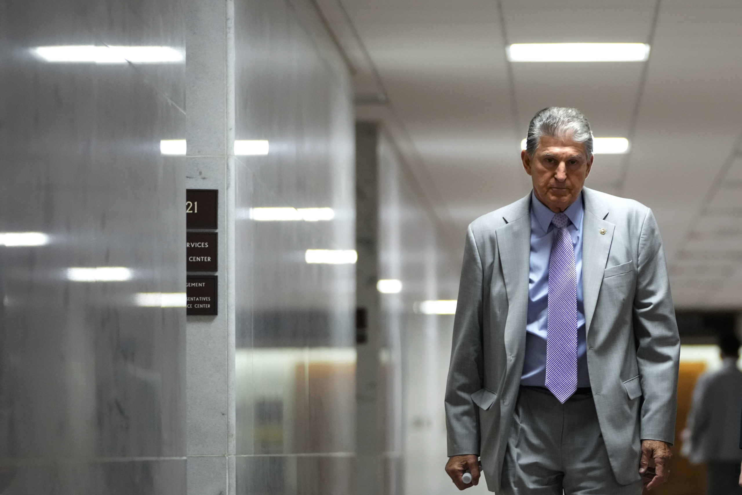 WASHINGTON, DC - JUNE 9: Sen. Joe Manchin (D-WV walks through the Dirksen Senate Office building on Capitol Hill on June 9, 2021 in Washington, DC. Over the weekend, Manchin announced that he will not support the For The People Act, the voting rights legislation that Democrats are trying to pass through the Senate. (Photo by Drew Angerer/Getty Images)