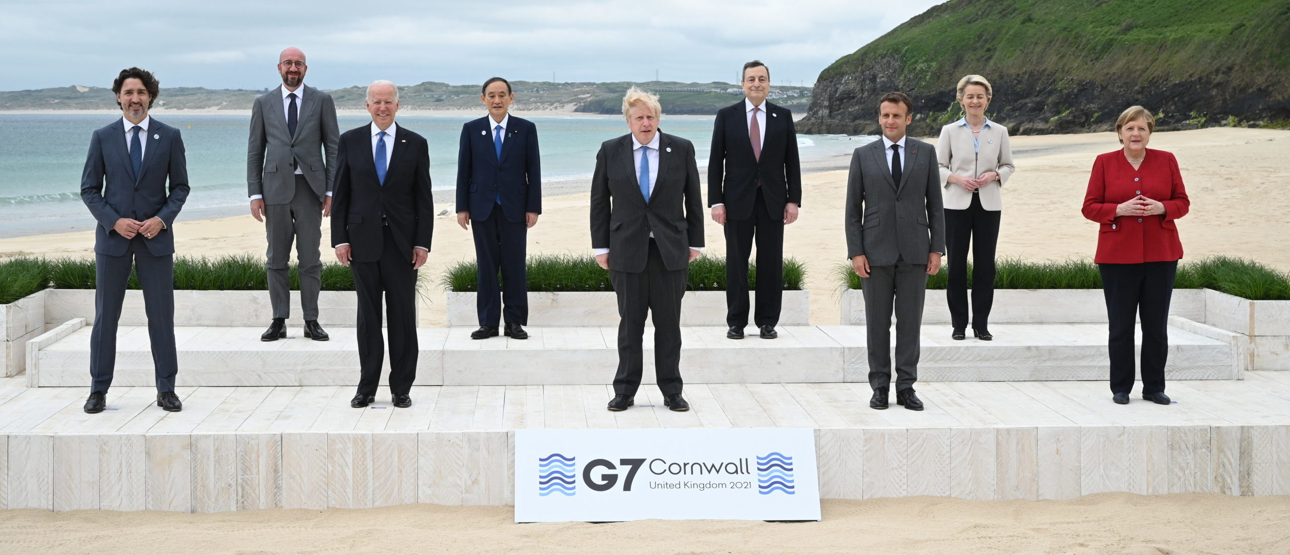 CARBIS BAY, CORNWALL - JUNE 11: (L-R) Canadian Prime Minister Justin Trudeau, President of the European Council Charles Michel, US President Joe Biden, Japanese Prime Minister Yoshihide Suga, British Prime Minister Boris Johnson, Italian Prime Minister Mario Draghi, French President Emmanuel Macron, President of the European Commission Ursula von der Leyen and German Chancellor Angela Merkel, pose for the Leaders official welcome and family photo during the G7 Summit In Carbis Bay, on June 11, 2021 in Carbis Bay, Cornwall. UK Prime Minister, Boris Johnson, hosts leaders from the USA, Japan, Germany, France, Italy and Canada at the G7 Summit. This year the UK has invited India, South Africa, and South Korea to attend the Leaders' Summit as guest countries as well as the EU. (Leon Neal - WPA Pool/Getty Images)