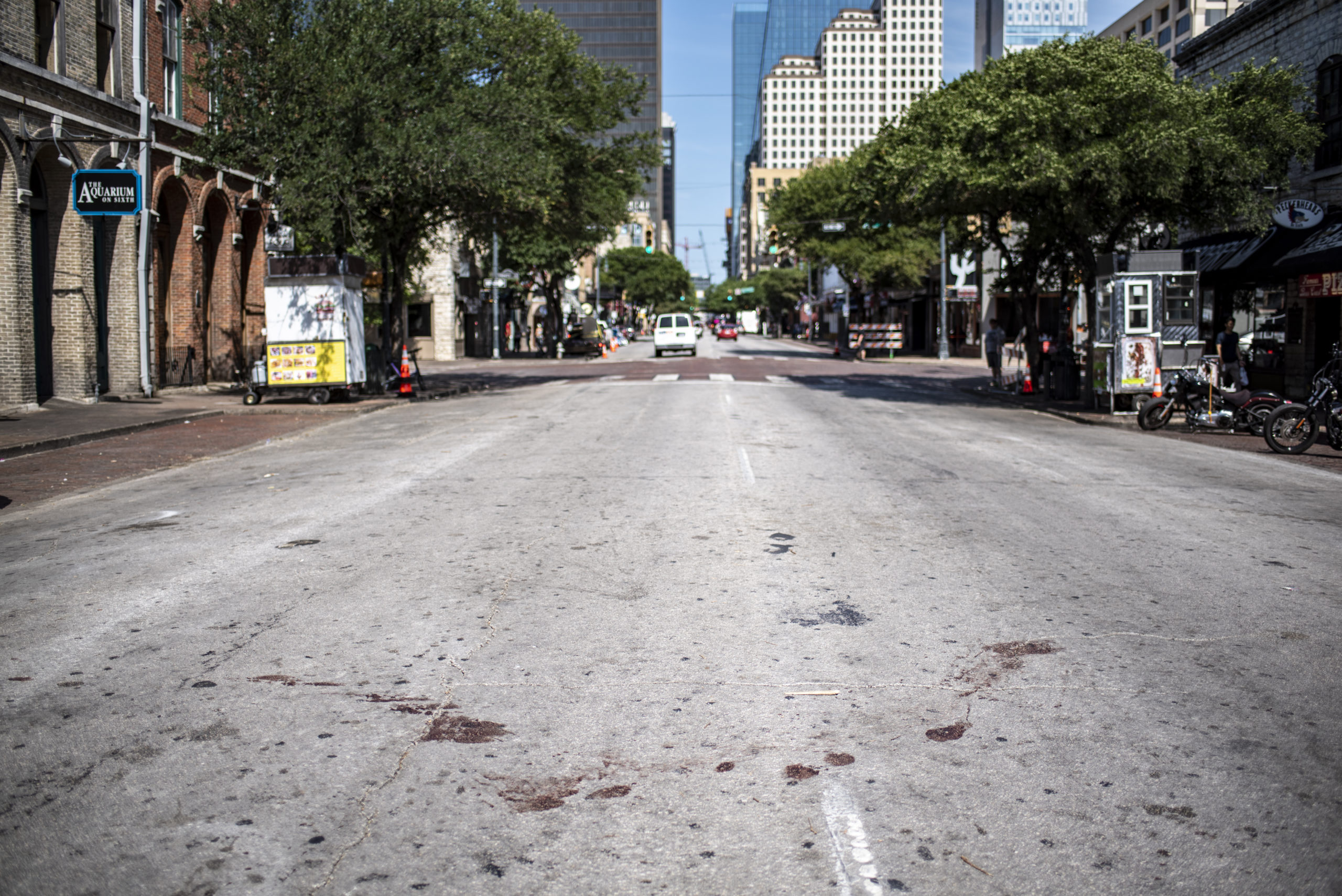 The street is stained with blood near the scene of a shooting on June 12, 2021 in Austin, Texas. At least 13 people were taken to hospitals after a shooting happened on Austin's famous 6th Street. The shooter is still at large. (Photo by Sergio Flores/Getty Images)