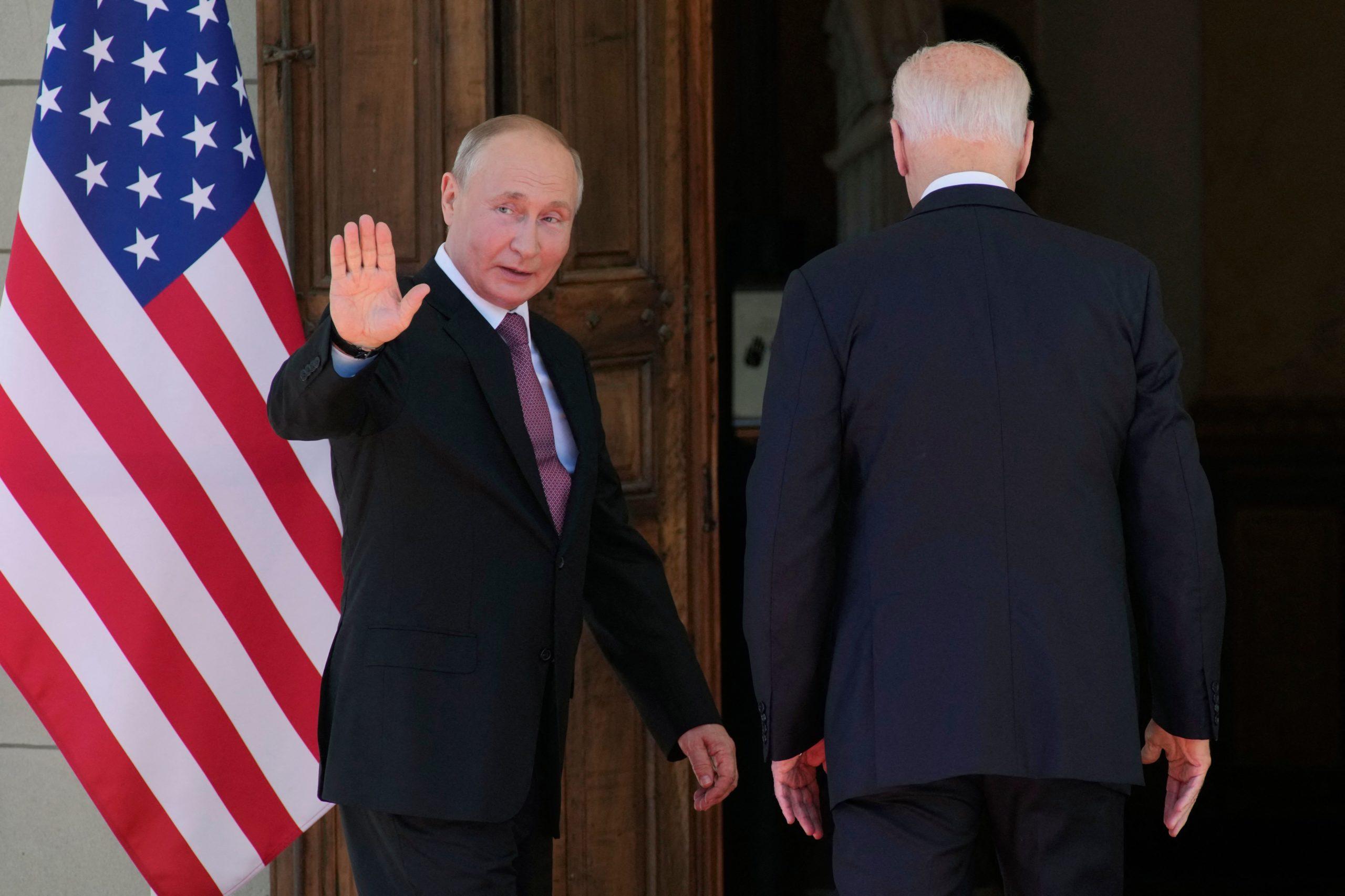 Russian President Vladimir Putin (L) waves next to U.S President Joe Biden as they enter the Villa La Grange for the U.S.-Russia summit, on June 16, 2021 in Geneva. (Photo by Alexander Zemlianichenko / POOL / AFP) (Photo by ALEXANDER ZEMLIANICHENKO/POOL/AFP via Getty Images)
