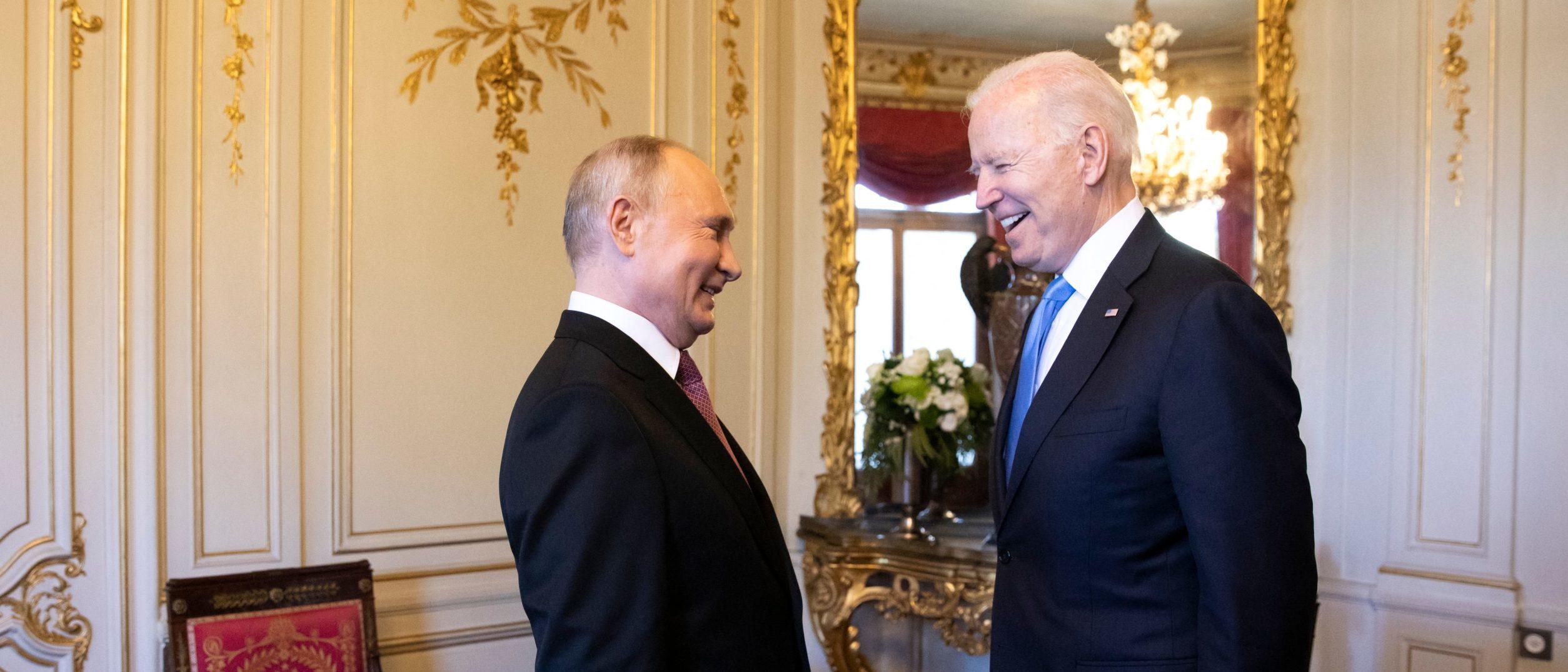 US President Joe Biden (R) talks to Russian President Vladimir Putin prior to the US-Russia summit at the Villa La Grange, in Geneva on June 16, 2021. (Photo by PETER KLAUNZER / POOL / AFP) (Photo by PETER KLAUNZER/POOL/AFP via Getty Images)