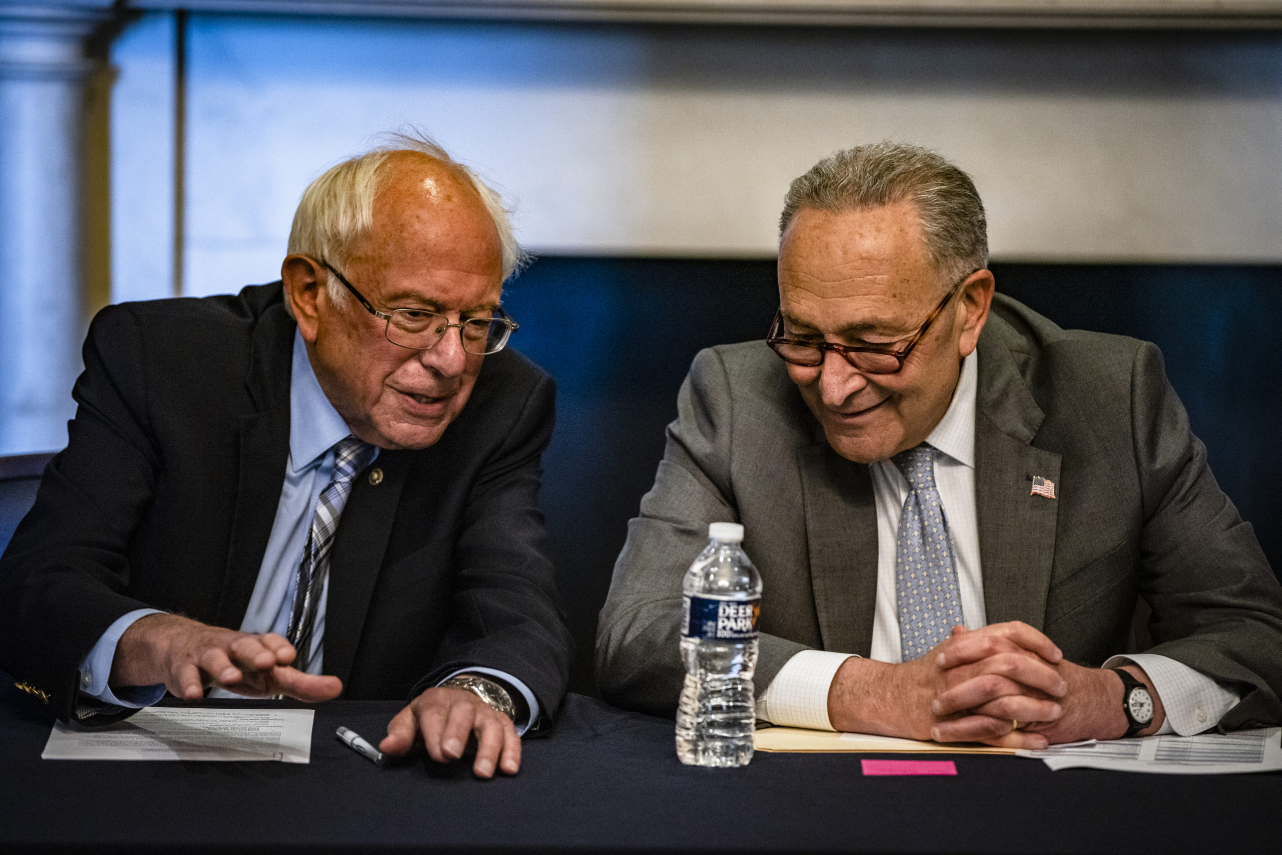 Senate Majority Leader Chuck Schumer and Budget Committee Chairman Bernie Sanders meet with Democrats about how to move forward with a second reconciliation package. (Samuel Corum/Getty Images)
