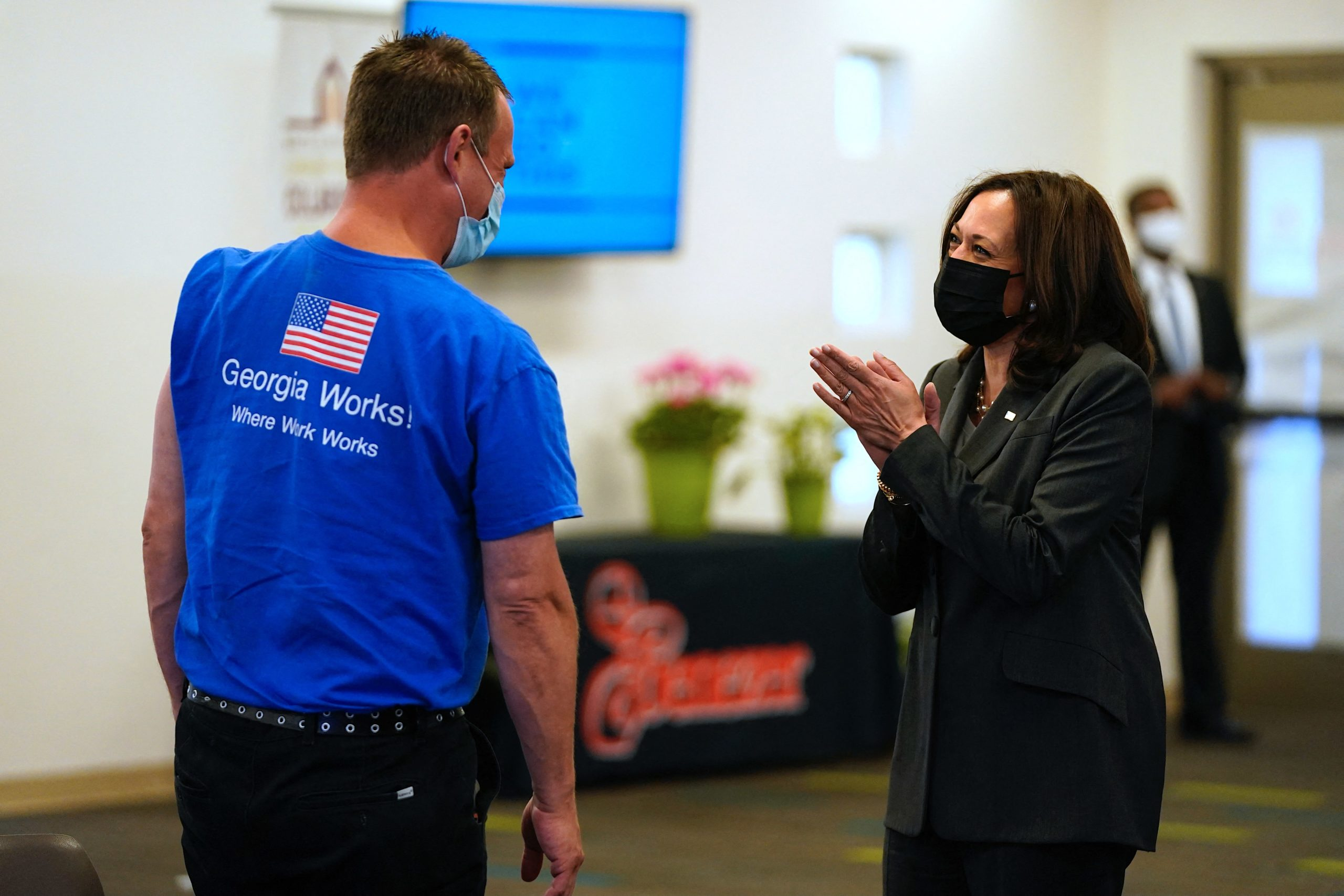 US Vice President Kamala Harris congratulates a man who just received his Covid-19 vaccination as she tours a vaccination clinic at Ebenezer Baptist Church in Atlanta, Georgia, on June 18, 2021. (ALEX EDELMAN/AFP via Getty Images)