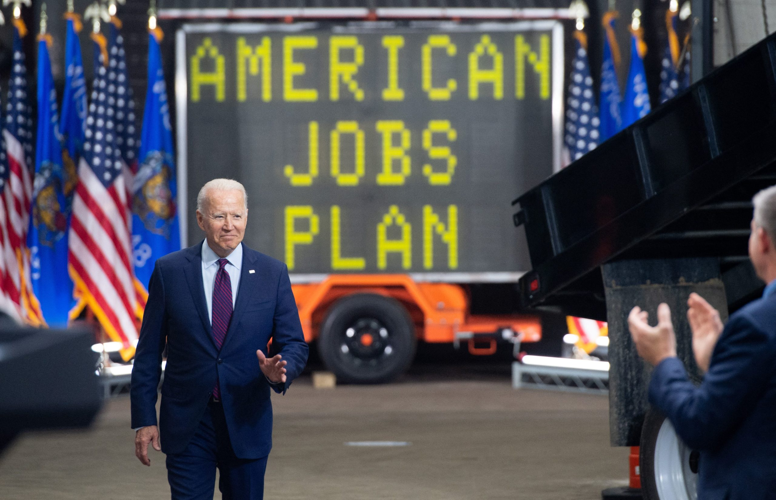 TOPSHOT - US President Joe Biden arrives to speak about the administration's infrastructure plans after touring the La Crosse Municipal Transit Utility in La Crosse, Wisconsin, June 29, 2021. (Photo by SAUL LOEB / AFP) (Photo by SAUL LOEB/AFP via Getty Images)