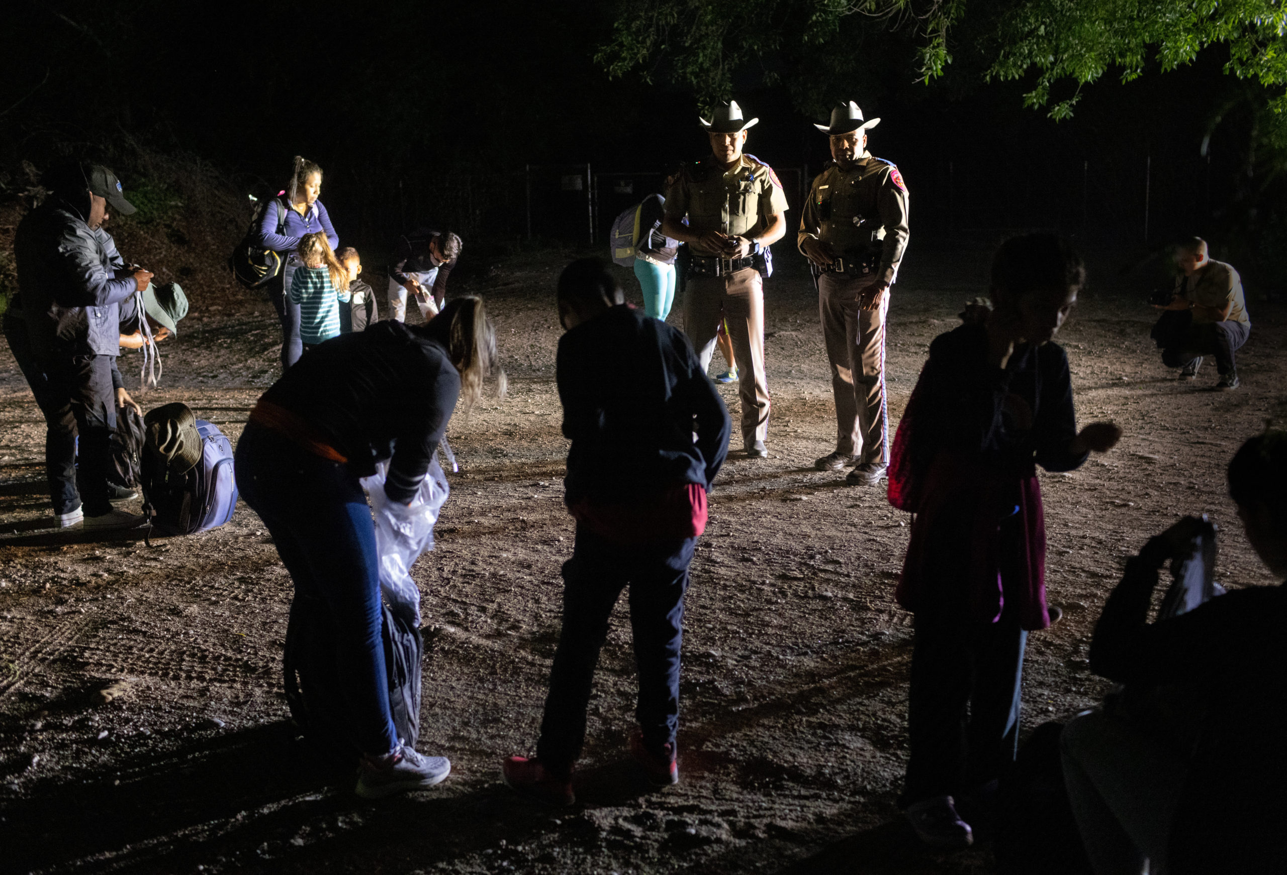 Texas state troopers watch over Venezuelan immigrants before they are taken into custody by U.S. Border Patrol agents on May 19, 2021 in Del Rio, Texas. (Photo by John Moore/Getty Images)