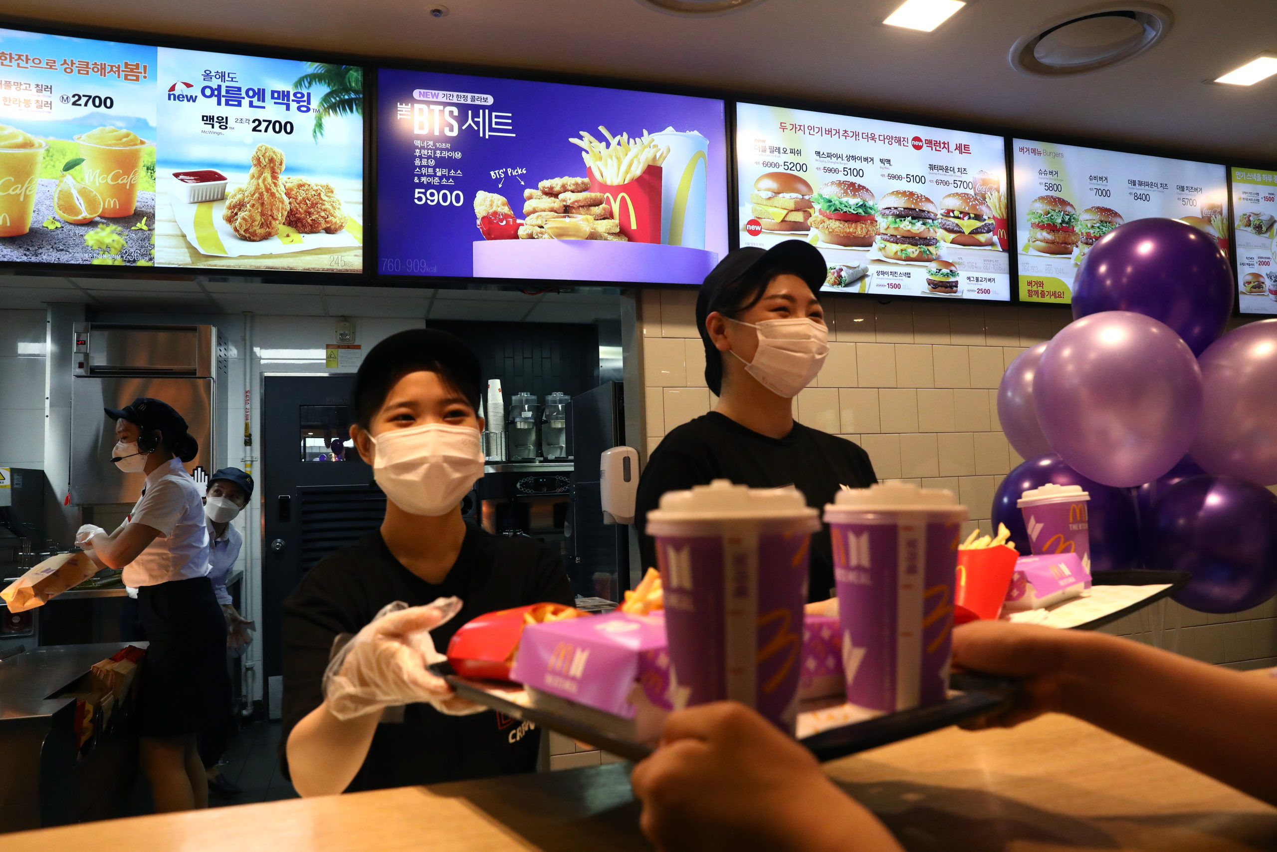 McDonald's employees serve a meal on May 27 in Seoul, South Korea. (Chung Sung-Jun/Getty Images)