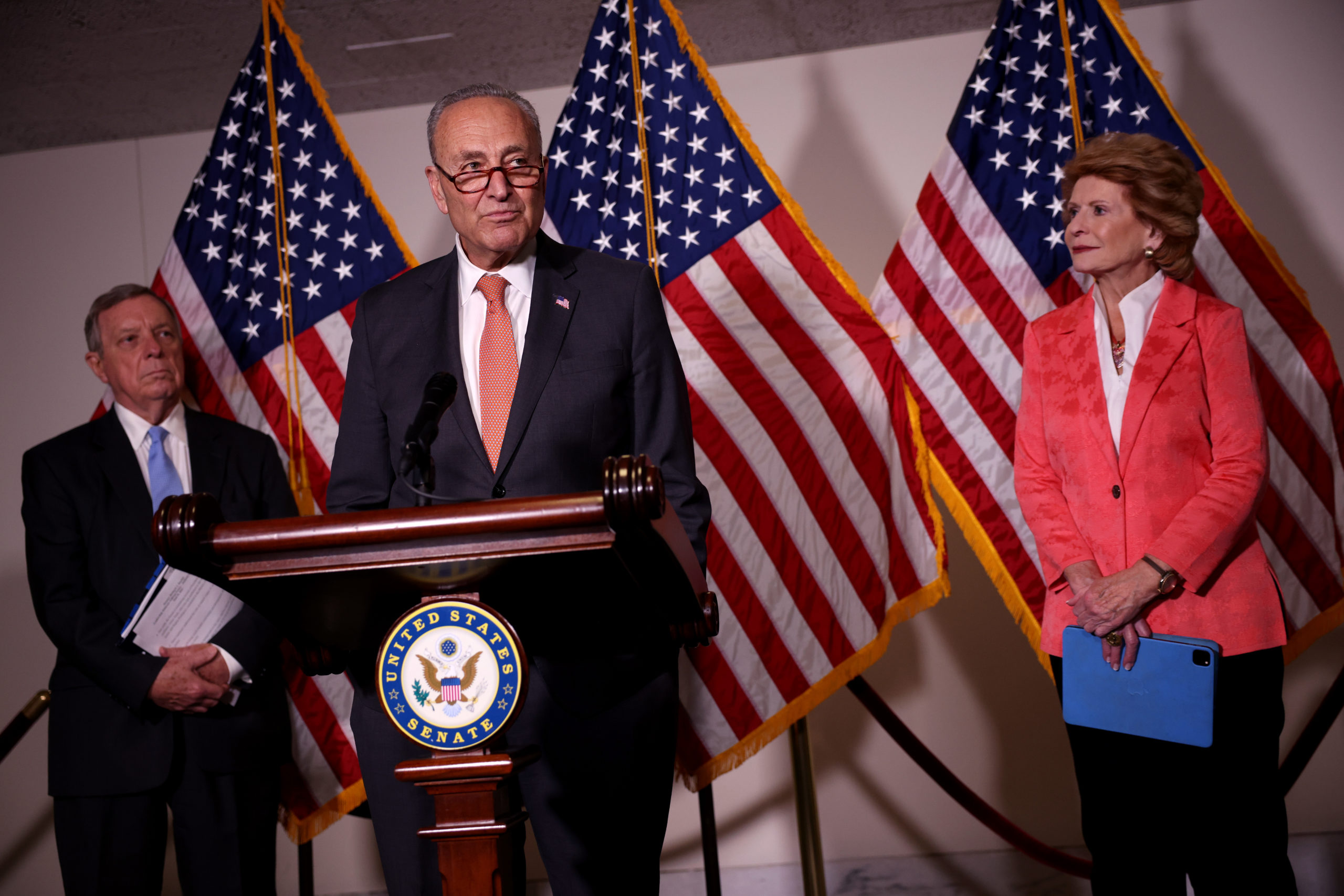 WASHINGTON, DC - JUNE 08: Senate Majority Leader Charles Schumer (D-NY) speaks alongside Sen. Richard Durbin (D-IL) (L) and Sen. Debbie Stabenow (D-MI) (R) at a press conference following a Senate Democratic luncheon on Capitol Hill on June 08, 2021 in Washington, DC. Schumer spoke on the equal pay, infrastructure and Democratic judicial nominees. (Photo by Kevin Dietsch/Getty Images)