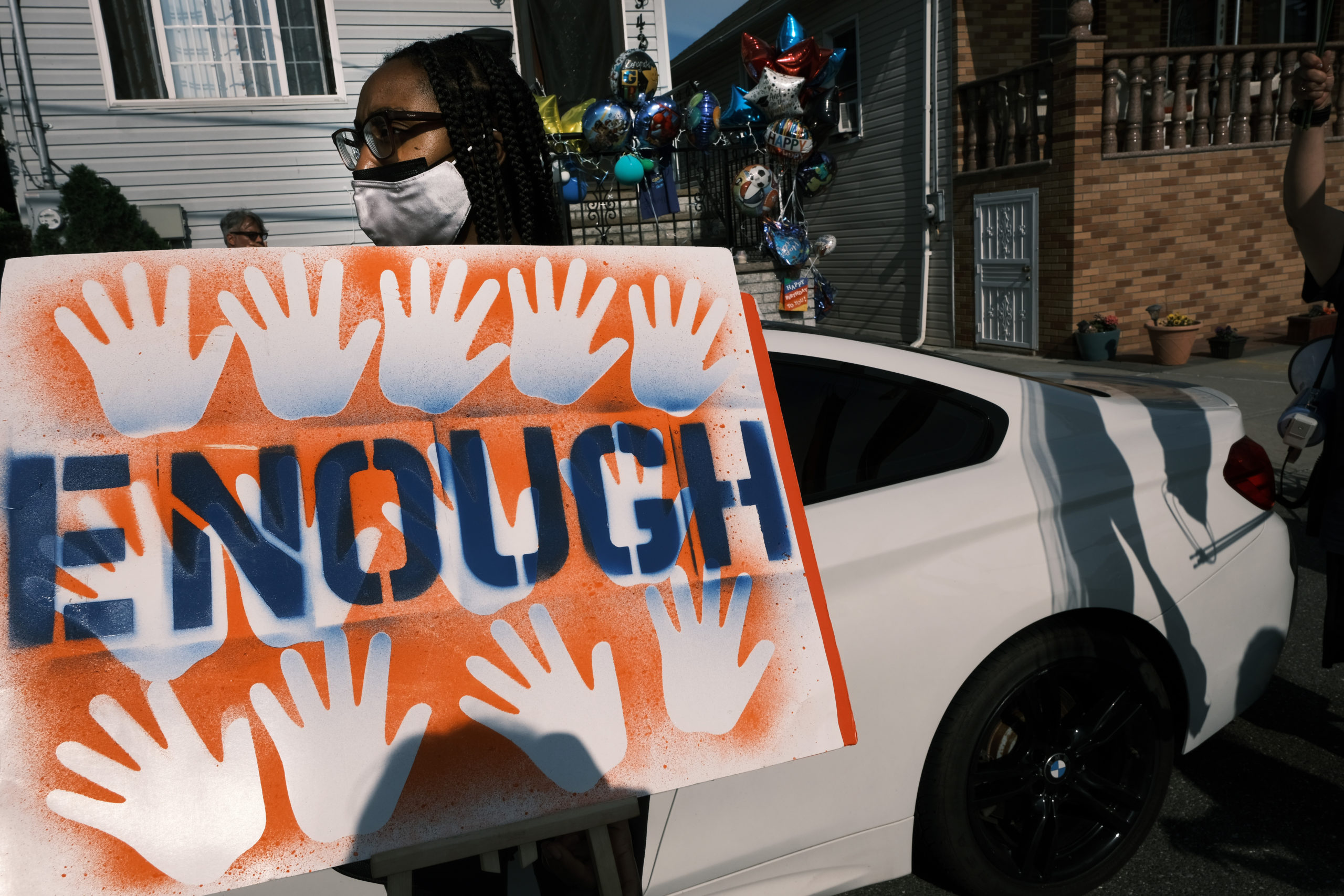 Activists, politicians and community members and others attend a peace vigil to end gun violence in front of the house where a boy was recently shot in the Rockaway section of Queens on June 09, 2021 in New York City. (Spencer Platt/Getty Images)