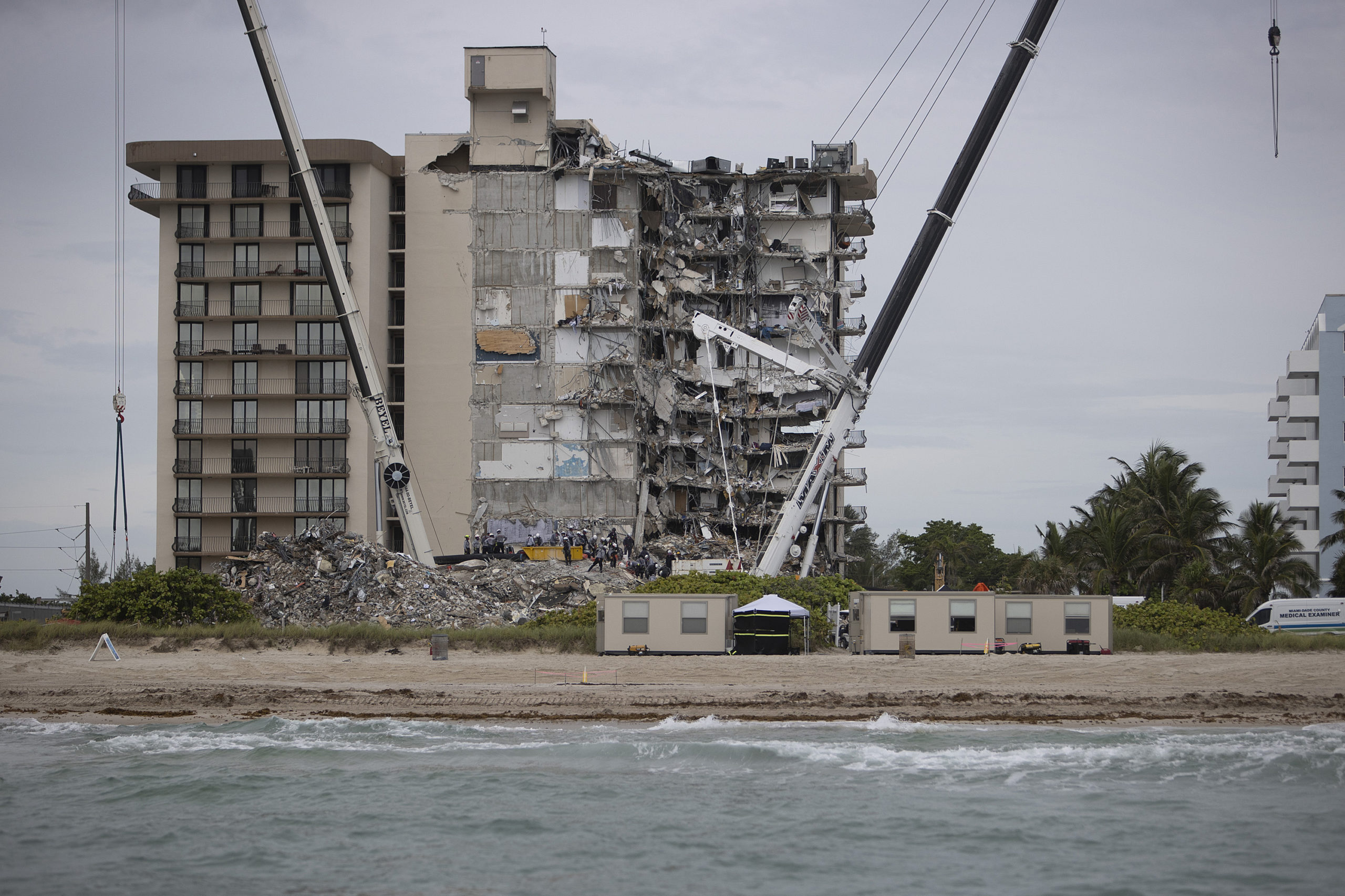 Search and Rescue teams look for possible survivors and to recover remains in the partially collapsed 12-story Champlain Towers South condo building on June 29, 2021 in Surfside, Florida. Over one hundred people are being reported as missing as the search-and-rescue effort continues. (Photo by Joe Raedle/Getty Images)