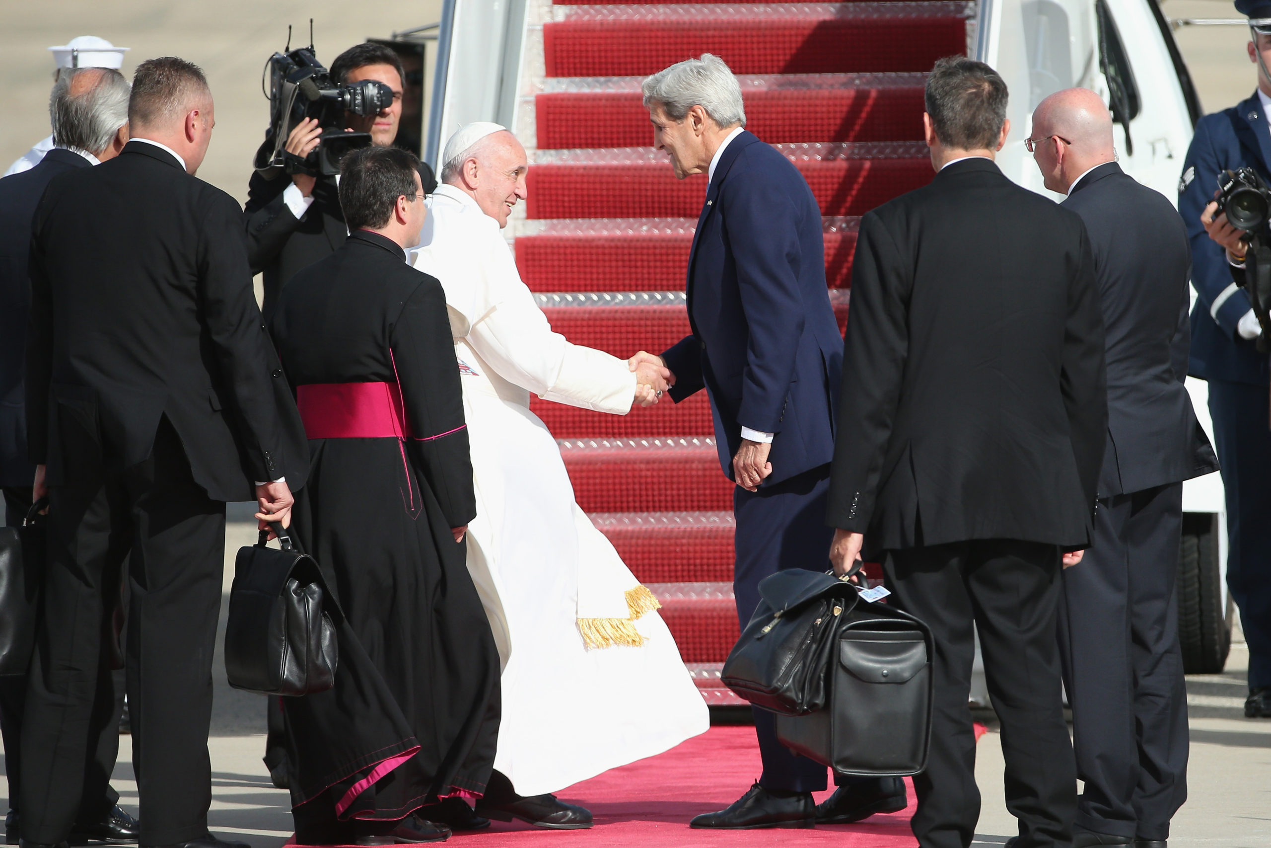 JOINT BASE ANDREWS, MD - SEPTEMBER 24: Pope Francis bids farewell to Secretary of State John Kerry as he departs from Washington, DC en route to New York City on September 24, 2015 in Joint Base Andrews, Maryland.The Pope is on a six-day trip to the U.S., with stops in Washington, New York City and Philadelphia. (Photo by Patrick Smith/Getty Images)