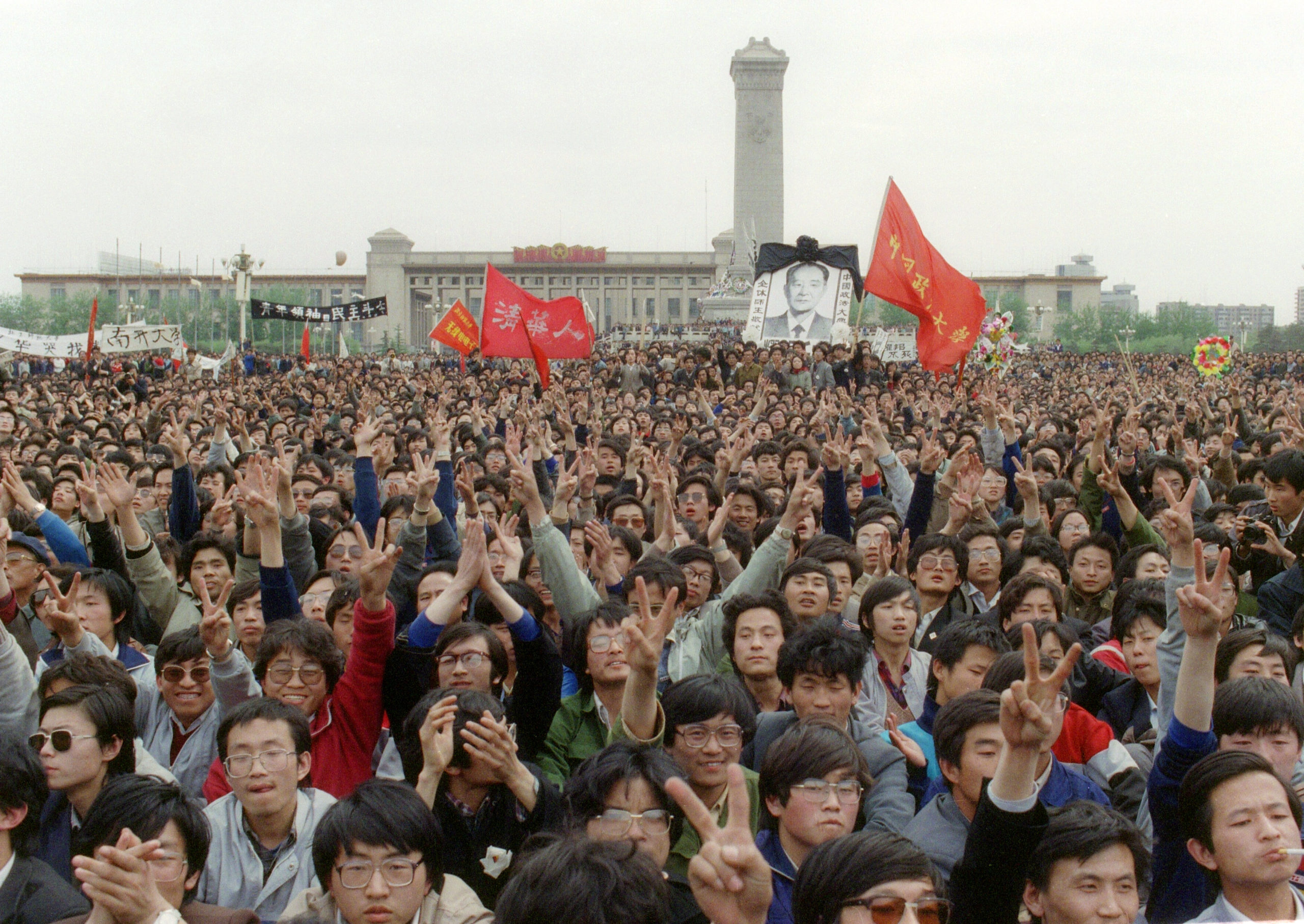 Students gesture and shout slogans during the 1989 protest in Tiananmen Square in Beijing, China. (Catherine Henriette/AFP via Getty Images)