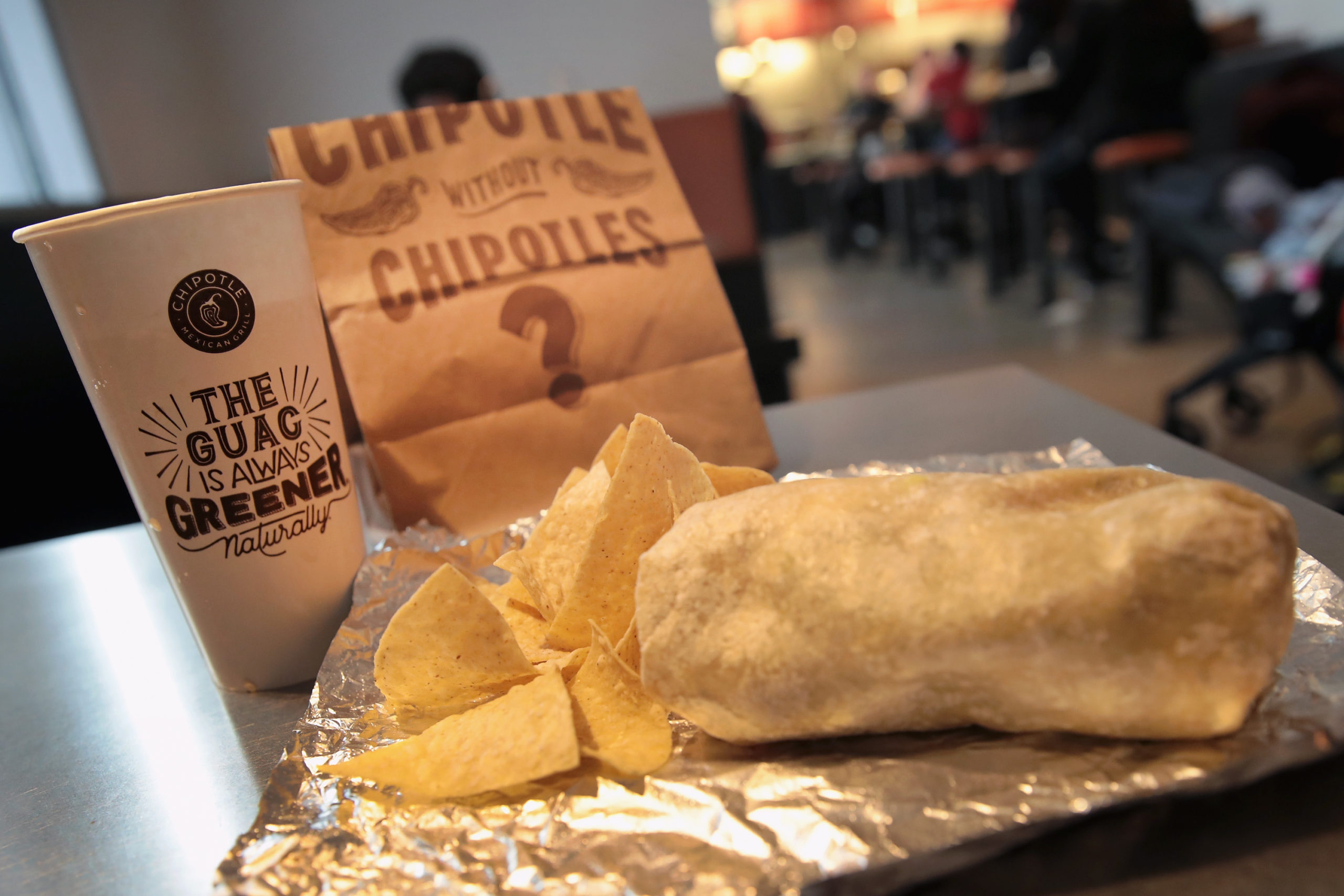 CHICAGO, IL - OCTOBER 25: Food is served at a Chipotle restaurant on October 25, 2017 in Chicago, Illinois. Chipotle stock fell more than 14 percent today after a weak 3Q earnings. (Photo Illustration by Scott Olson/Getty Images)
