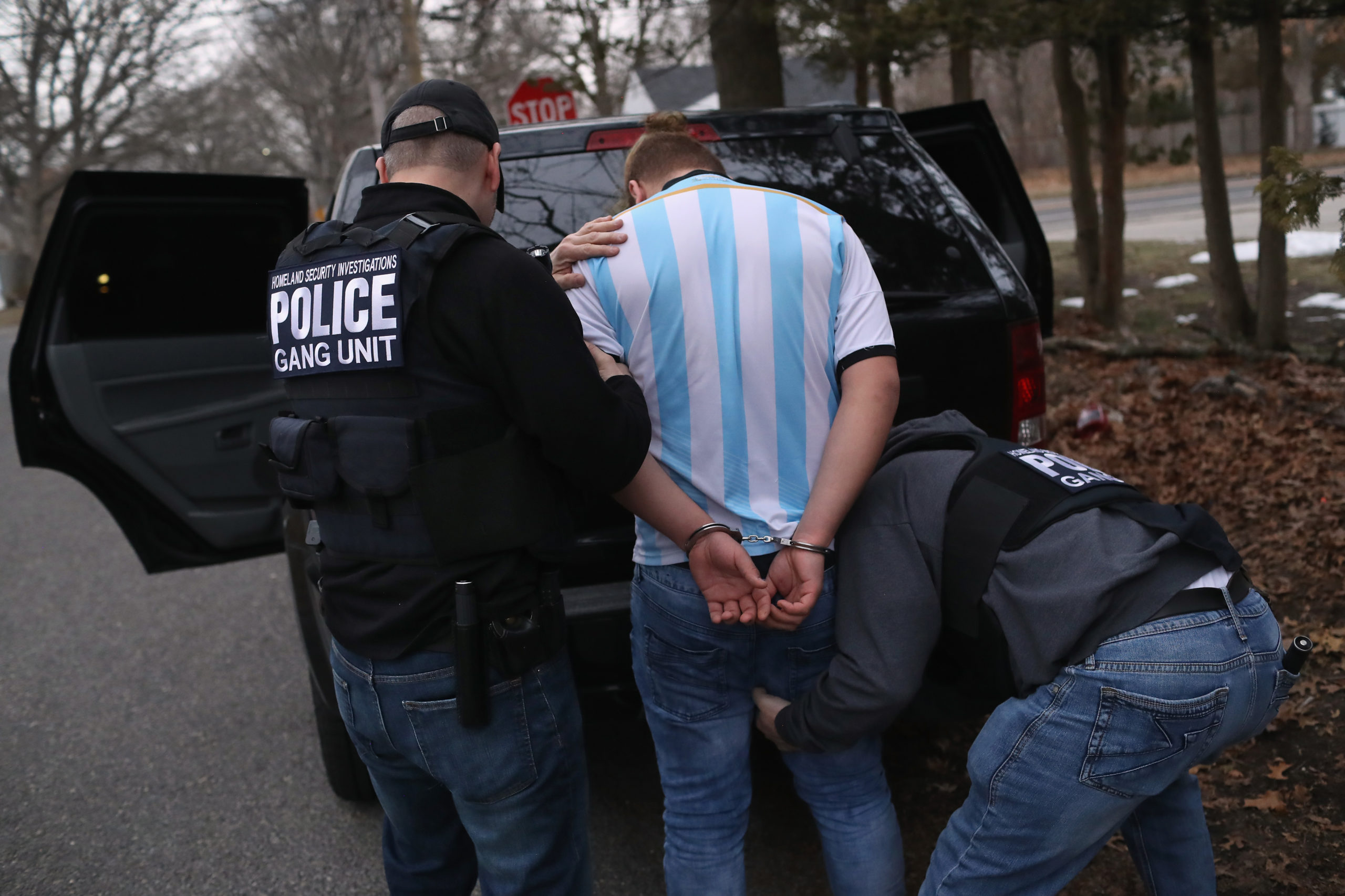 BRENTWOOD, NY - MARCH 29: Homeland Security Investigations (HSI) ICE agents frisk a suspected MS-13 gang member and Honduran immigrant after arresting him at his home on March 29, 2018 in Brentwood, New York. Overnight and into the morning federal agents and local police detained suspected gang members across Long Island in a surge of arrests. The actions were part of Operation Matador, a nearly year-long anti-gang effort targeting transnational gangs, with an emphasis on MS-13. (Photo by John Moore/Getty Images)