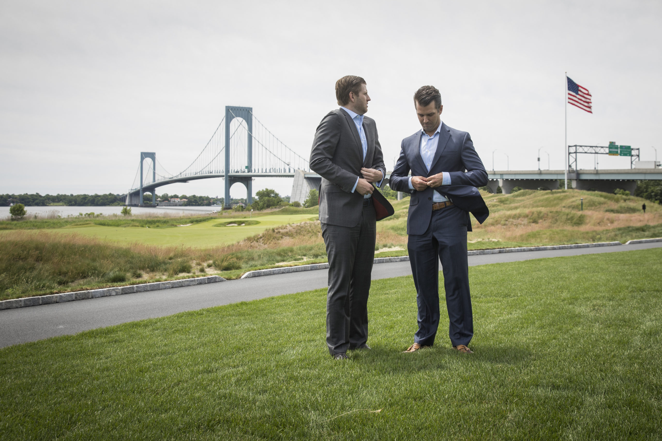 Eric Trump and Donald Trump Jr. prepare for the ribbon-cutting event at Trump Golf Links at Ferry Point on June 11, 2018. (Drew Angerer/Getty Images)