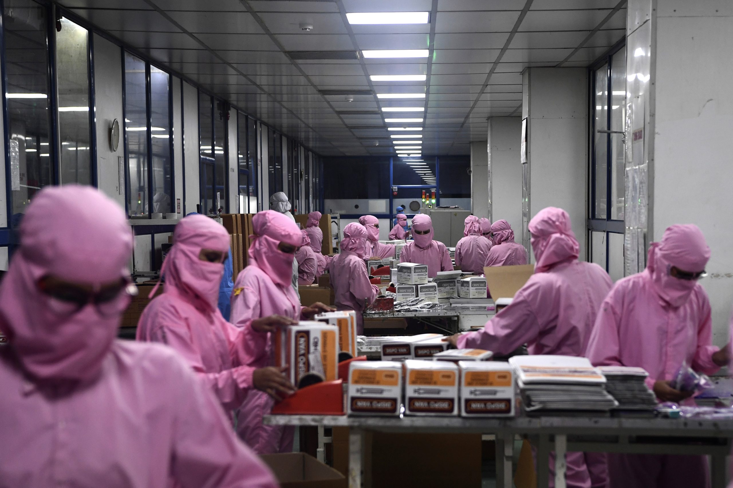 India's biggest syringe manufacturer is ramping up its production to churn out a billion units, anticipating a surge in demand as the global race to find a COVID-19 coronavirus vaccine heats up. (Photo by SAJJAD HUSSAIN / AFP) (Photo by SAJJAD HUSSAIN/AFP via Getty Images)