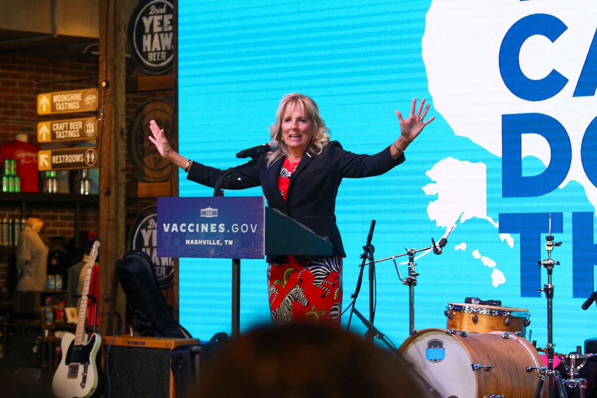 US First Lady Jill Biden gestures as she delivers remarks to a crowd inside the Ole Smoky distillery during a visit to promote Covid-19) vaccines, in Nashville, Tennessee, June 22, 2021. (Photo by TOM BRENNER/POOL/AFP via Getty Images)