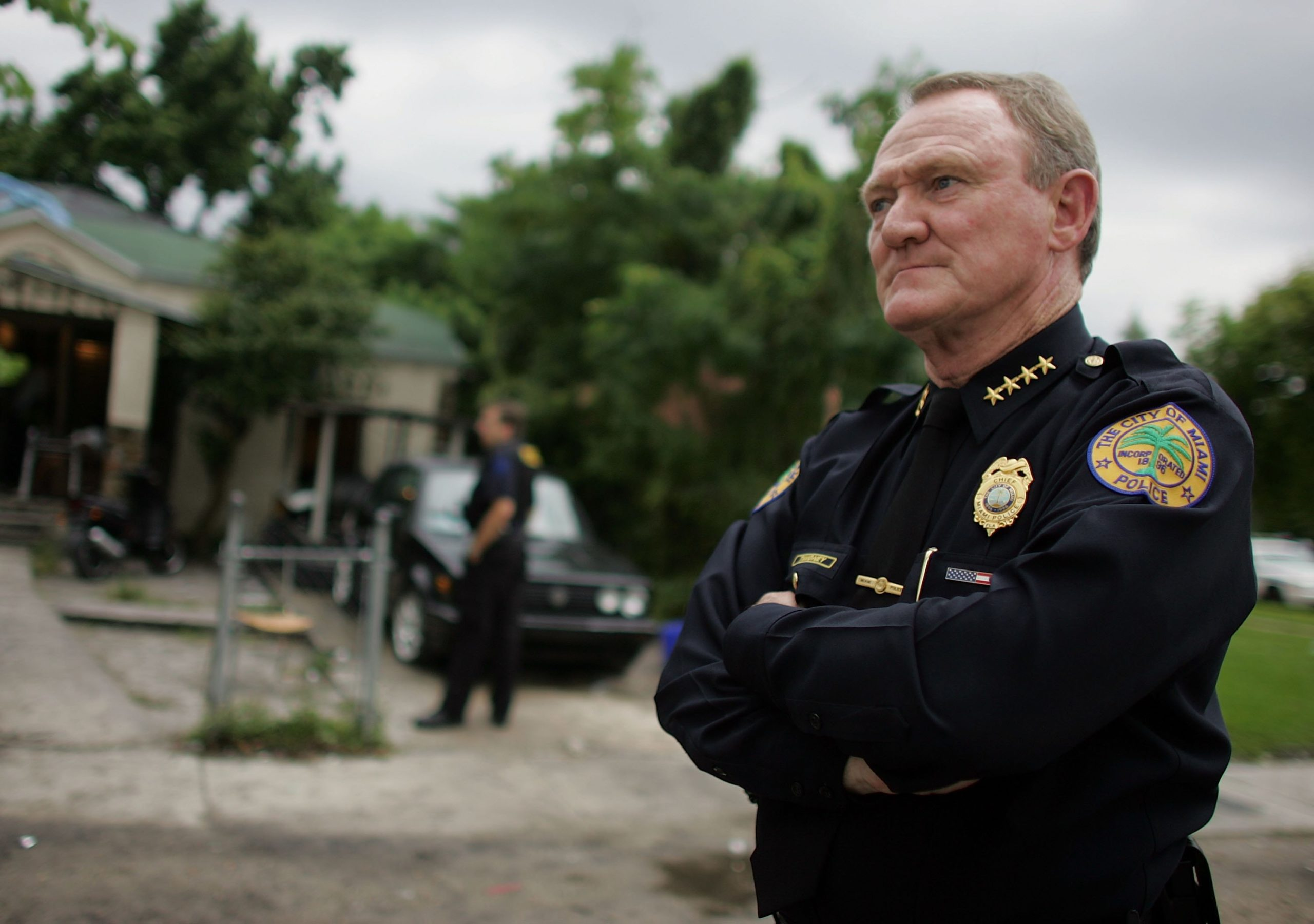 Miami Police Chief John Timoney stands in front of a home raided by police September 27, 2006 in Miami, Florida. The raid was part of an on going crack-down in a neighborhood affected by violence. (Photo by Joe Raedle/Getty Images)