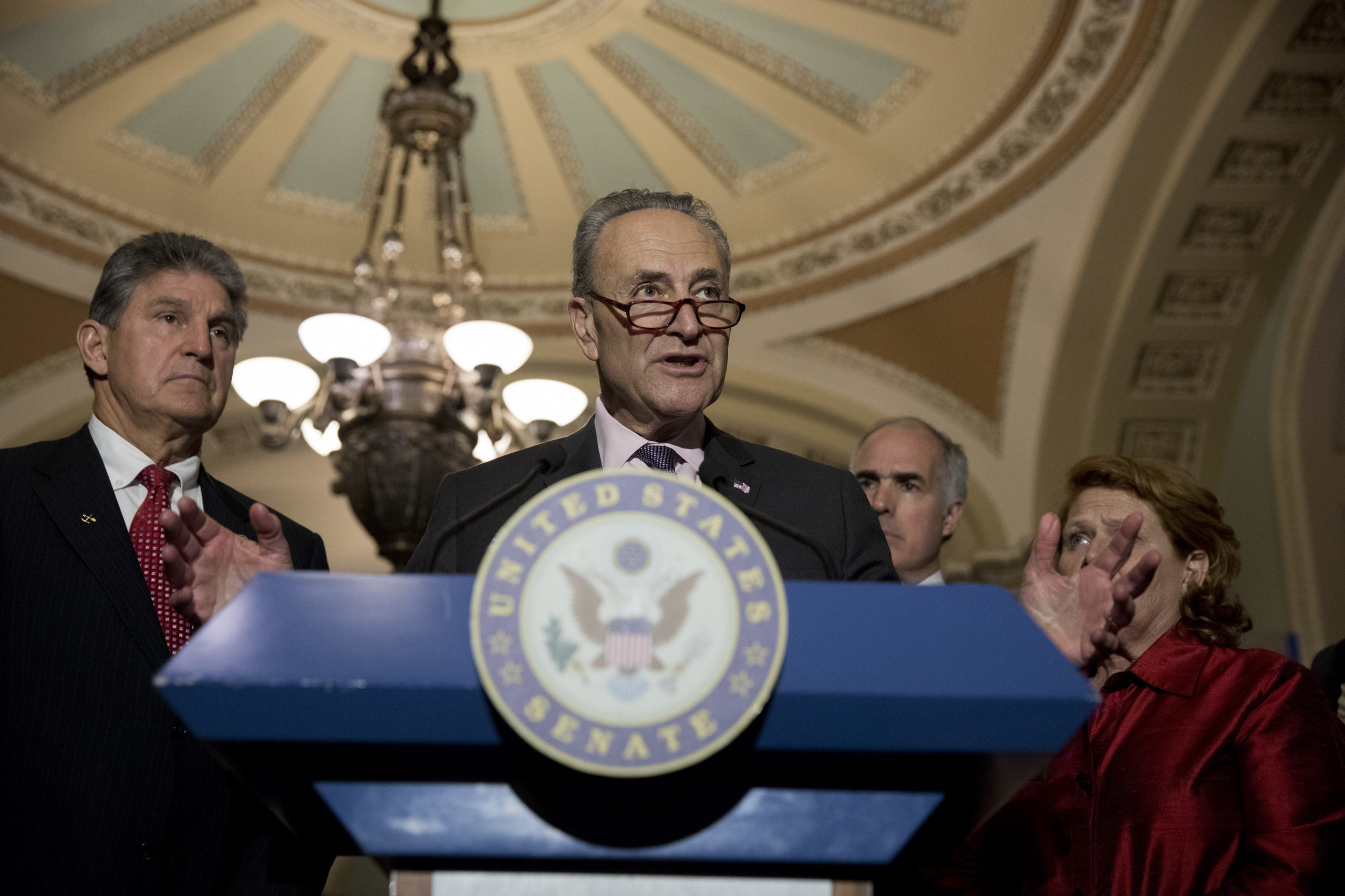Sen. Chuck Schumer with Sen. Joe Manchin, two Democrats at the center of the clash over the For the People Act. (Photo by Aaron P. Bernstein/Getty Images)