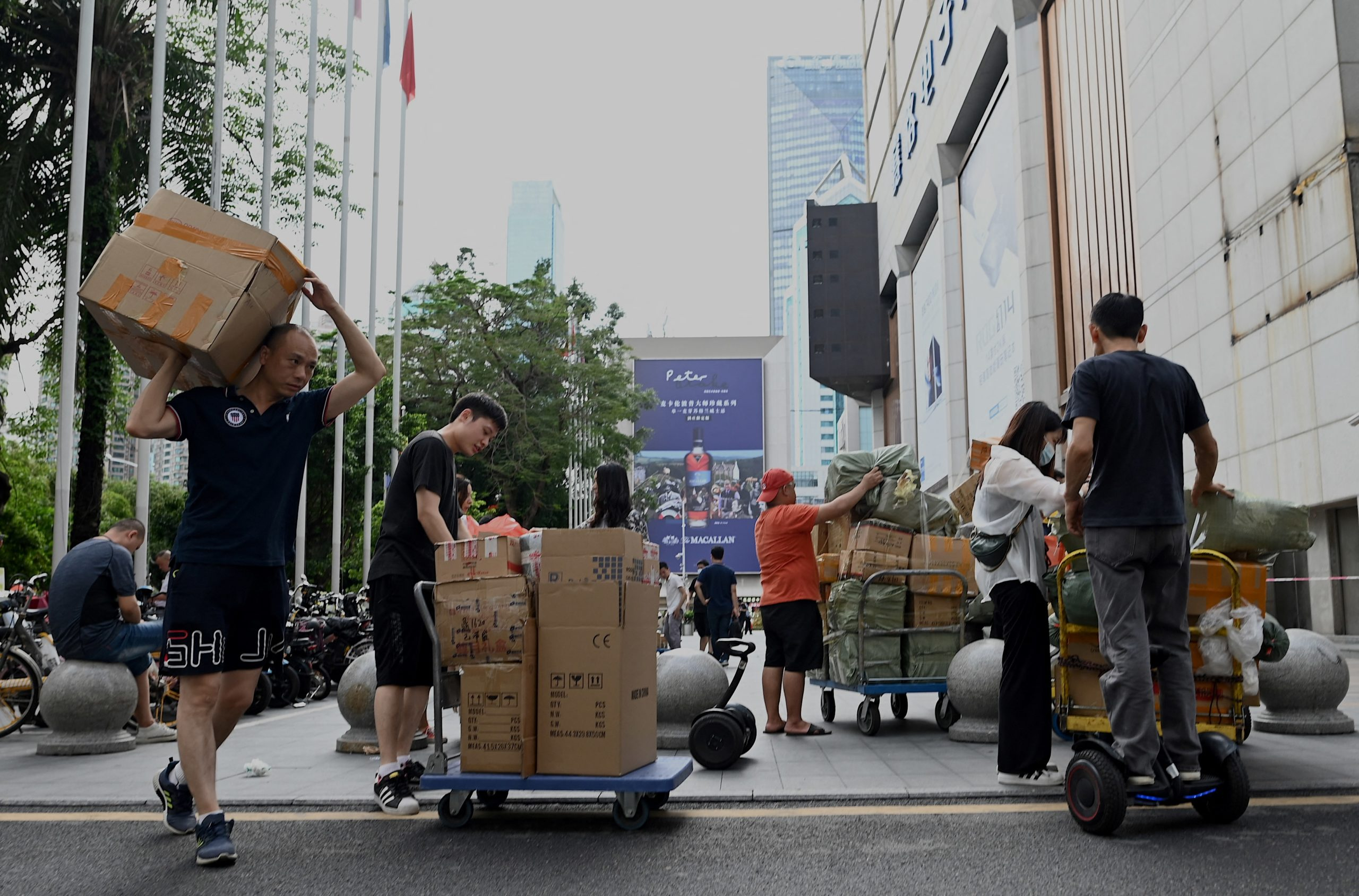 Workers move boxes in Shenzhen, one of China's special economic zones. (Photo by NOEL CELIS/AFP via Getty Images)
