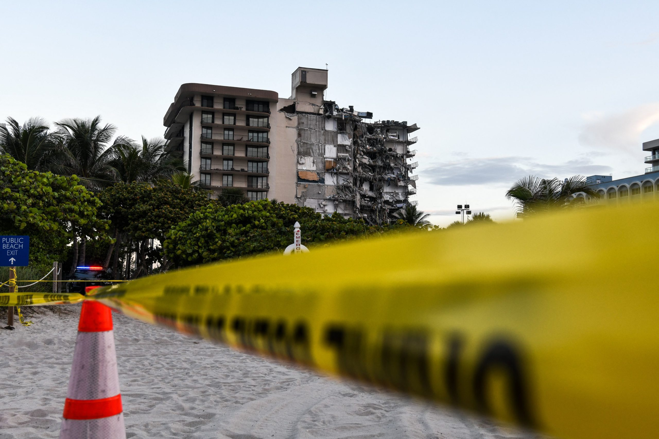 Police tape blocks access to a partially collapsed building in Surfside north of Miami Beach, on June 24, 2021. (Photo by CHANDAN KHANNA/AFP via Getty Images)