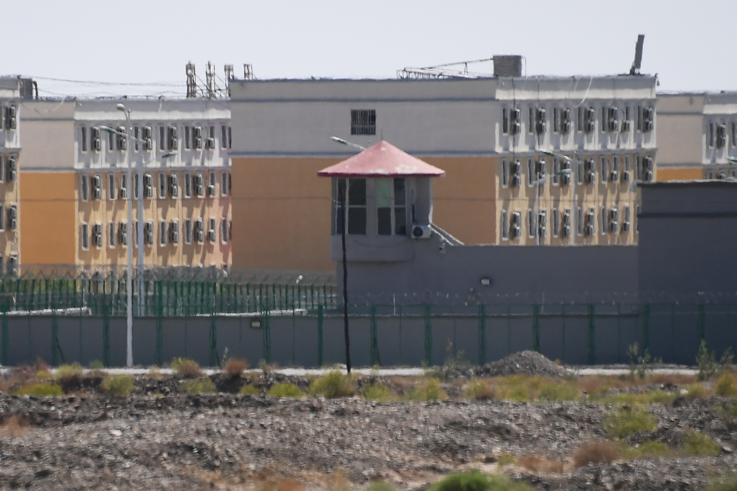 This photo taken on June 2, 2019 shows buildings at the Artux City Vocational Skills Education Training Service Center, believed to be a re-education camp where mostly Muslim ethnic minorities are detained, north of Kashgar in China's northwestern Xinjiang region. (Photo by GREG BAKER/AFP via Getty Images)