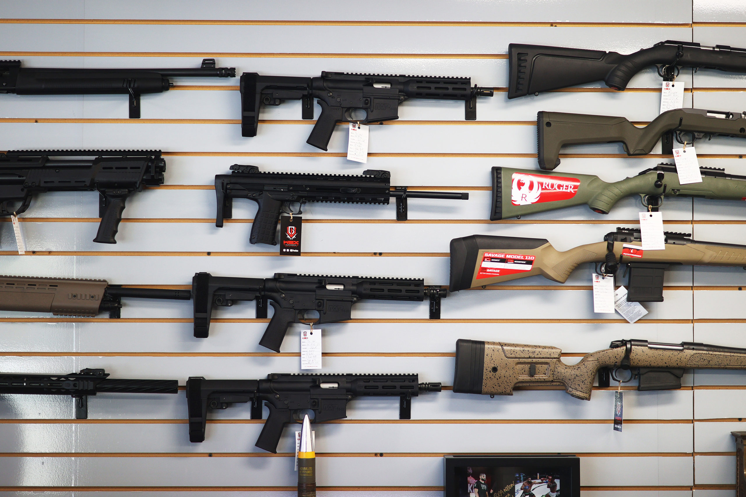 Weapons for sale hang on the wall at WEX Gunworks on March 24, 2021 in Delray Beach, Florida. (Photo by Joe Raedle/Getty Images)