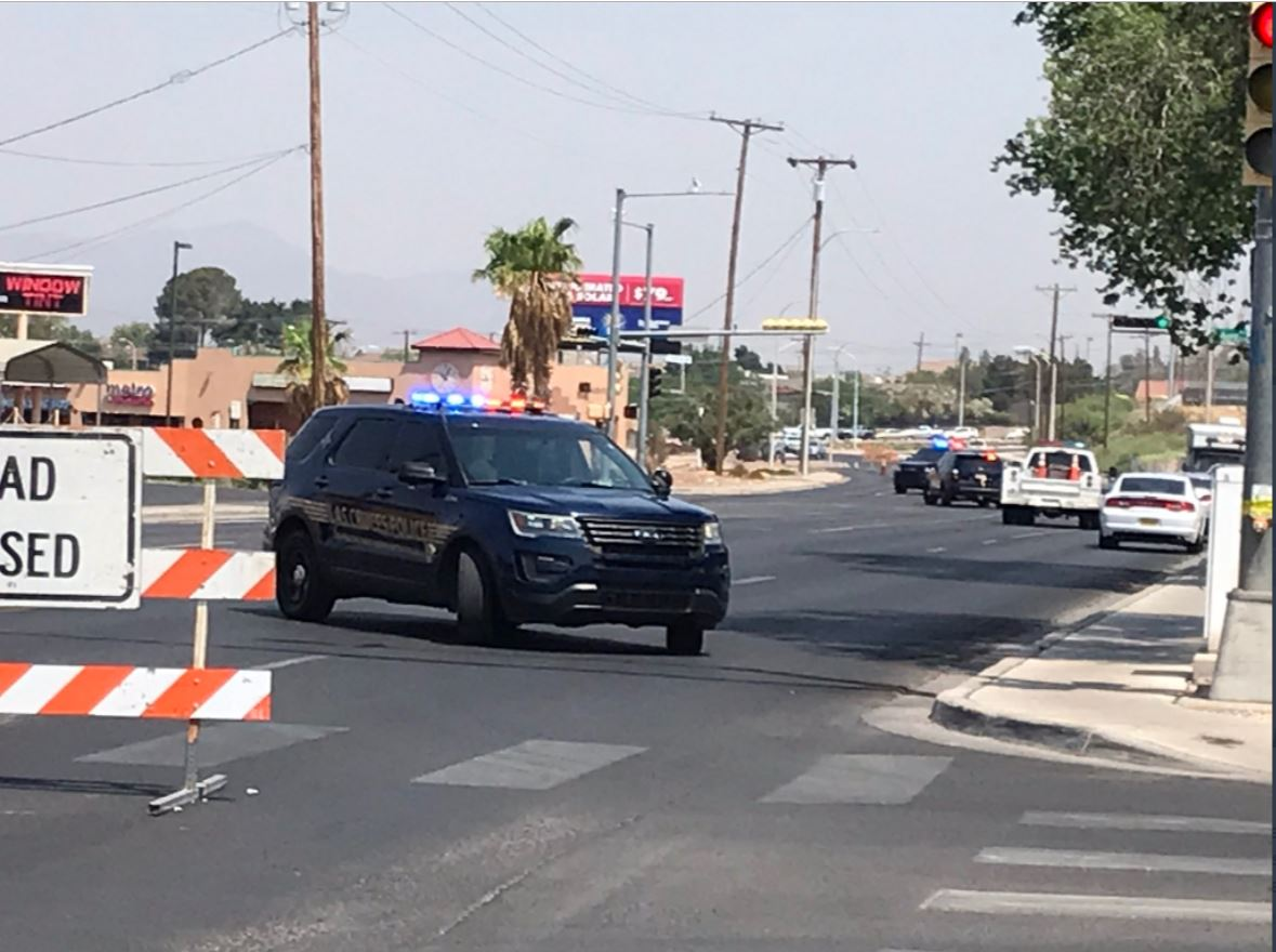 Police cruisers block off a street outside of Apodoca Park, Las Cruces. (Twitter/Screenshot/CBS 4 Local)